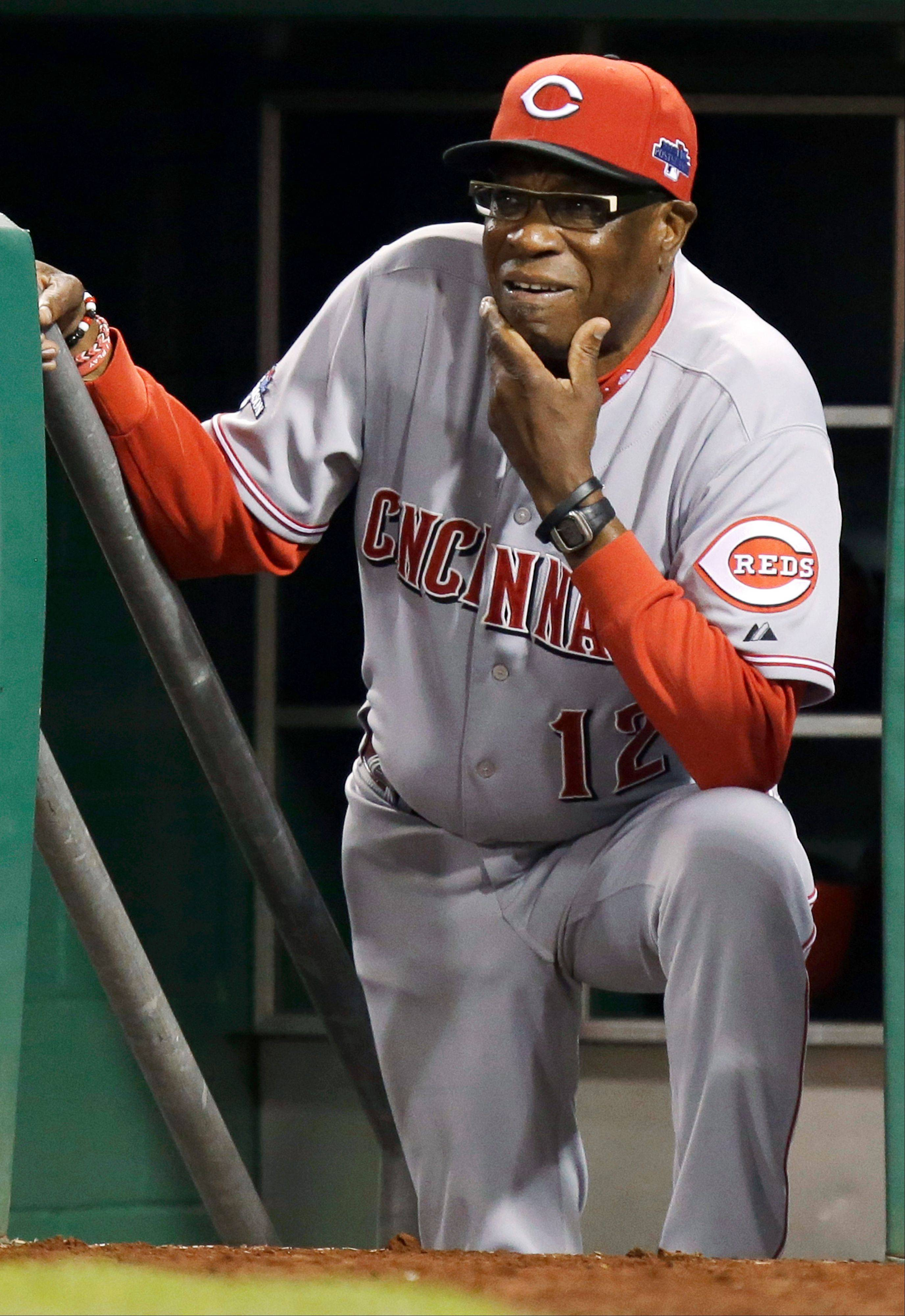 Cincinnati Reds manager Dusty Baker watches from the dugout steps as the Pittsburgh Pirates bat in the fifth inning of the NL wild-card playoff baseball game Tuesday, Oct. 1, 2013, in Pittsburgh.