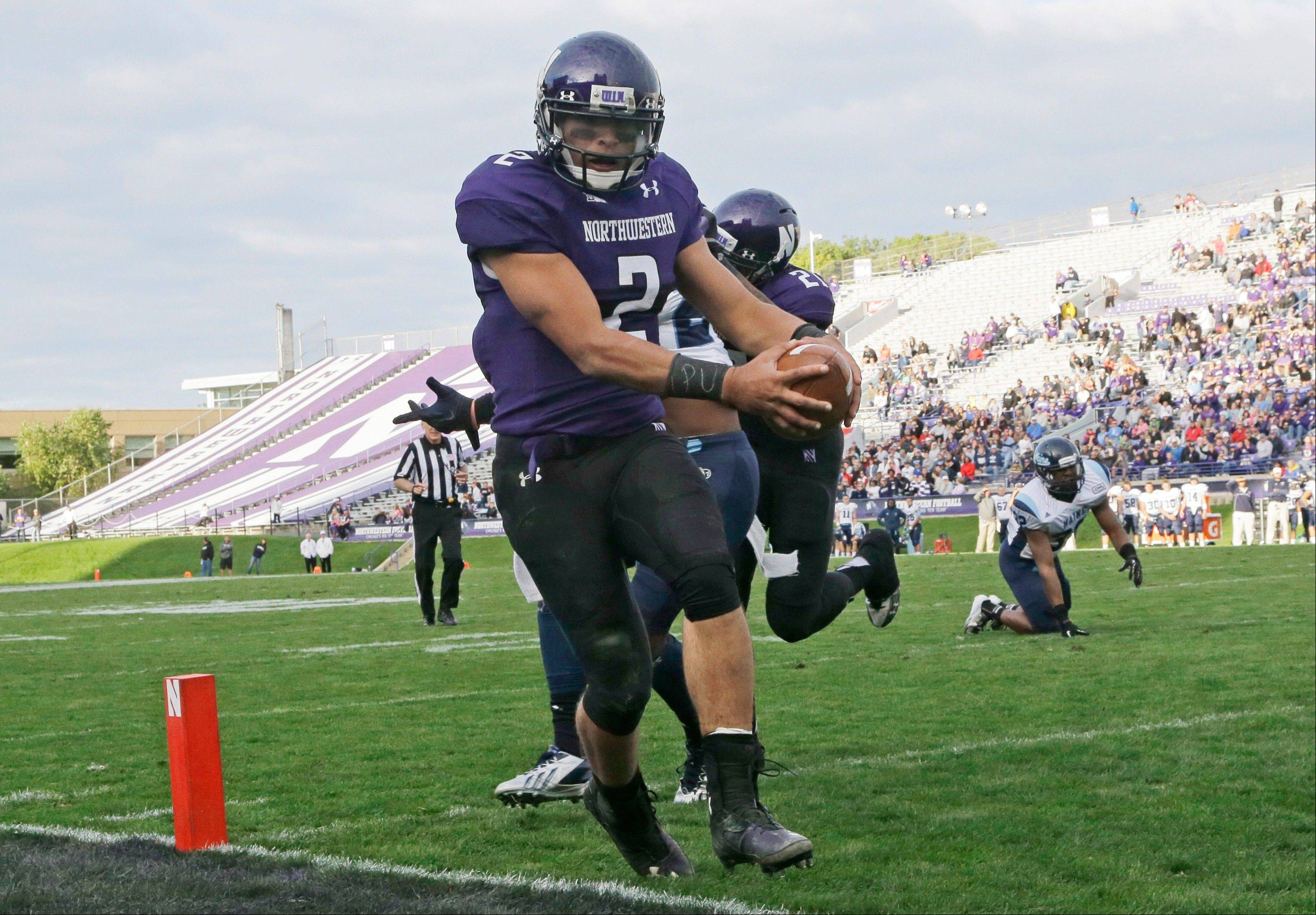 Northwestern quarterback Kain Colter scores a touchdown during the second half against Maine on Sept. 21 in Evanston.