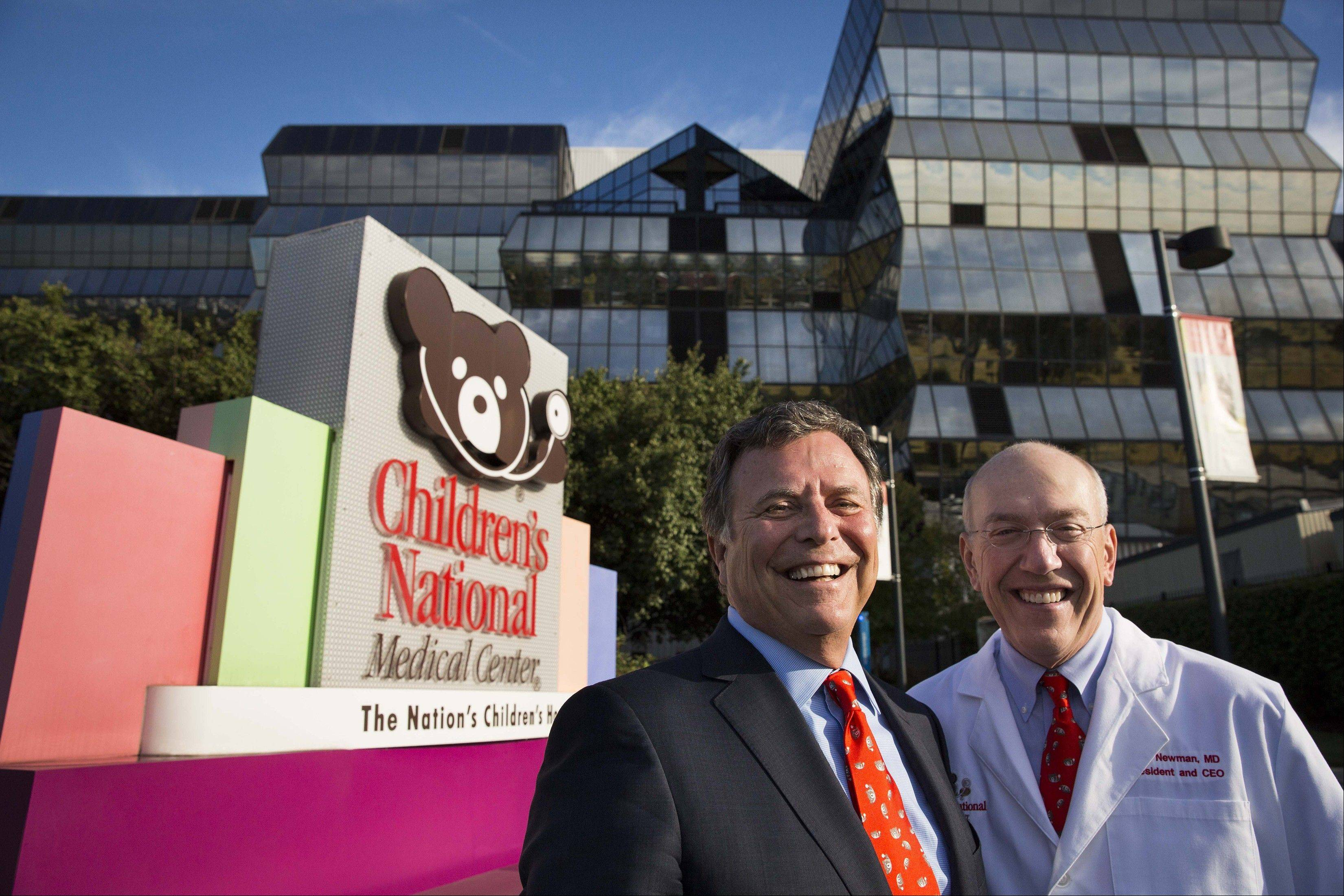 Cerner chief executive Neal Patterson and Children's Hospital chief executive Kurt Newman are working together on launching a pediatric IT center, which is expected to open in January.