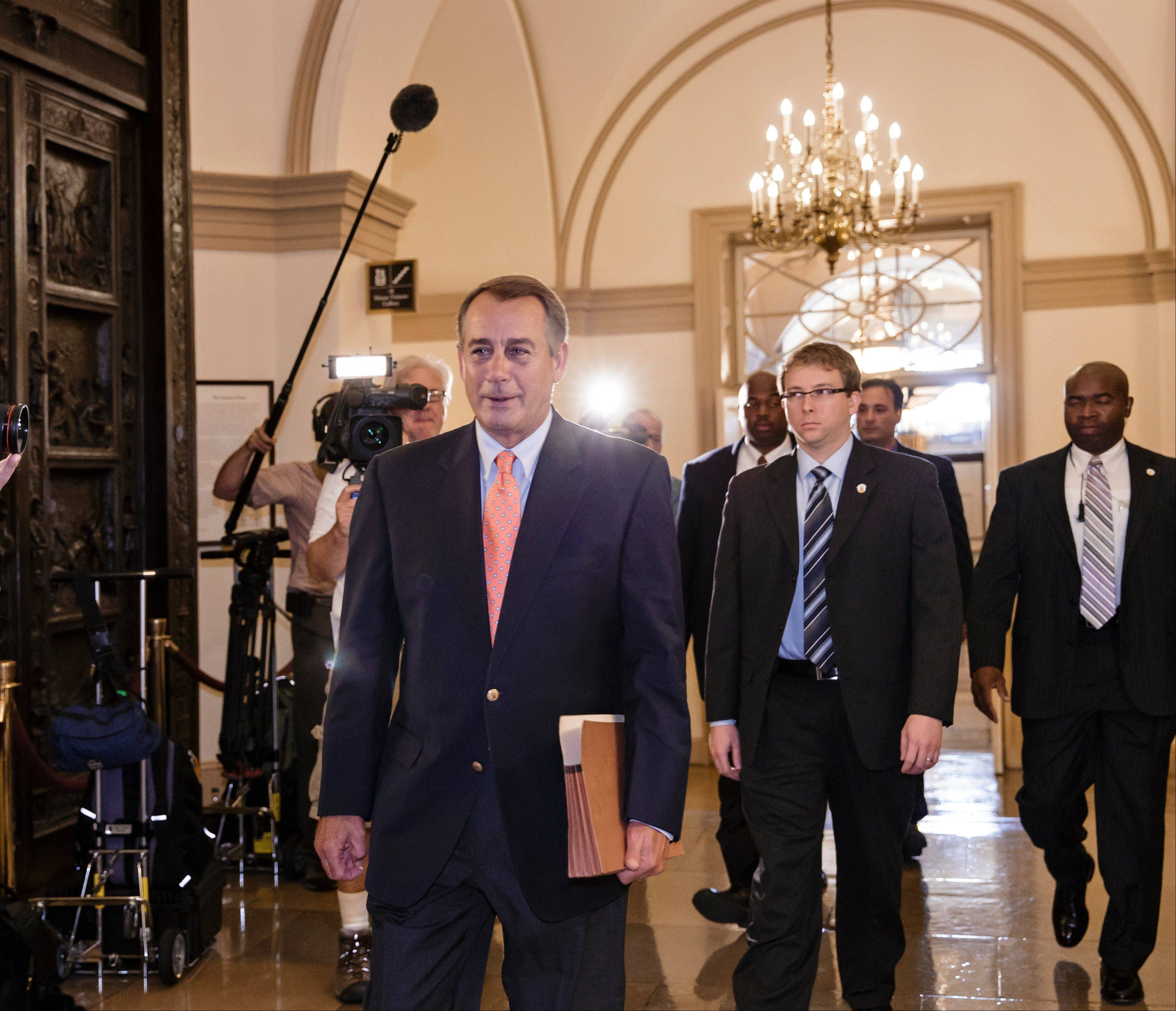 Speaker of the House John Boehner, R-Ohio, arrives at the Capitol in Washington, Saturday. The Republican-controlled House and the Democrat-controlled Senate are at an impasse, neither side backing down, after House GOP conservatives linked the funding bill to President Obama's existent health care law.