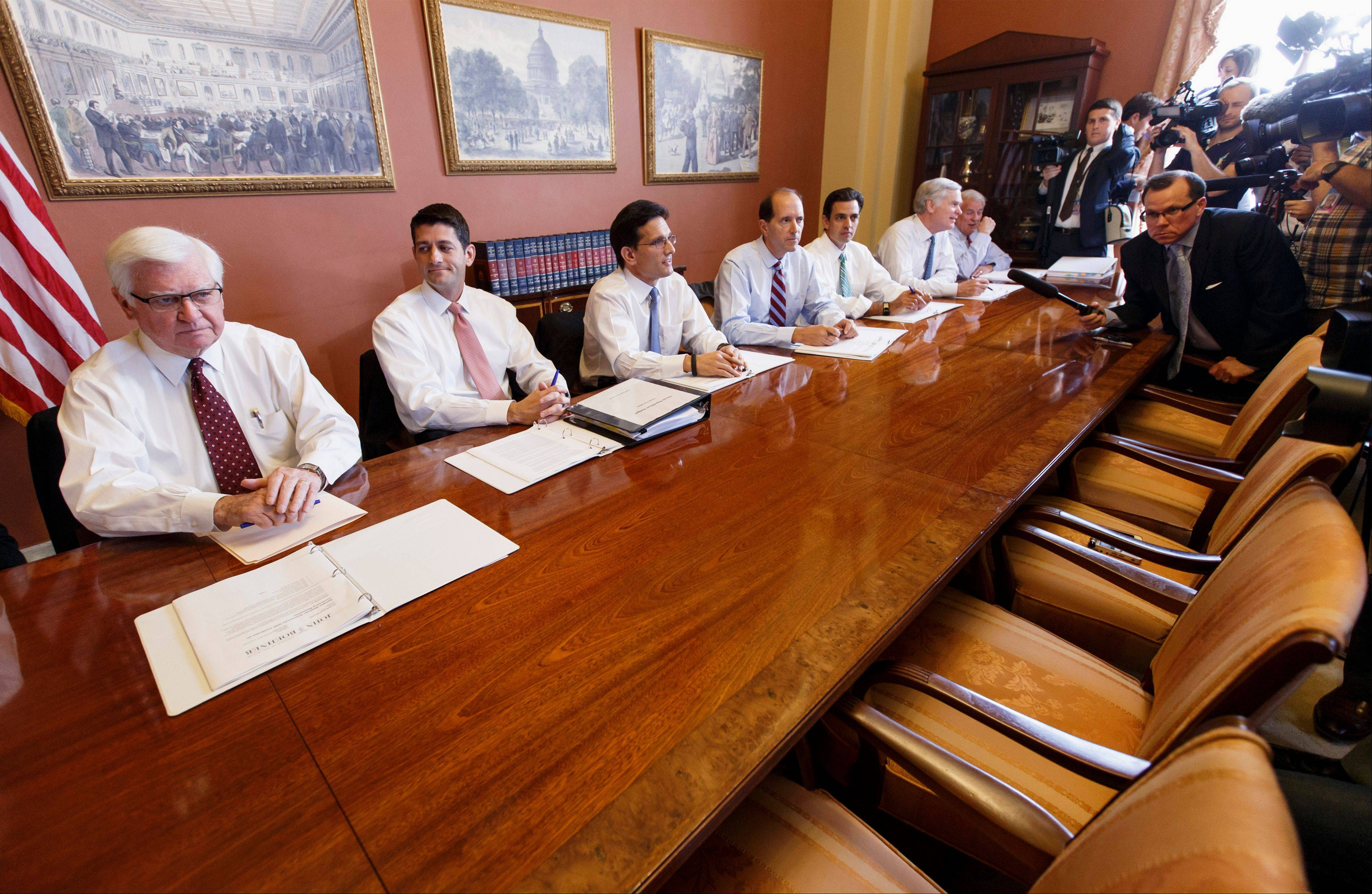 House Majority Leader Eric Cantor of Va., third from left, meets with House Republican conferees Tuesday on Capitol Hill in Washington. Cantor said the chairs opposite them were intended for Democrats to join in the discussions, but he said they declined. From left are House Appropriations Chairman Rep. Hal Rogers, R-Ky.; House Budget Committee Chairman Rep. Paul Ryan, R-Wis.; Cantor; House Ways and Means Committee Chairman Rep. Dave Camp, R-Mich.; Rep. Tom Graves, R-Ga., and other House members.