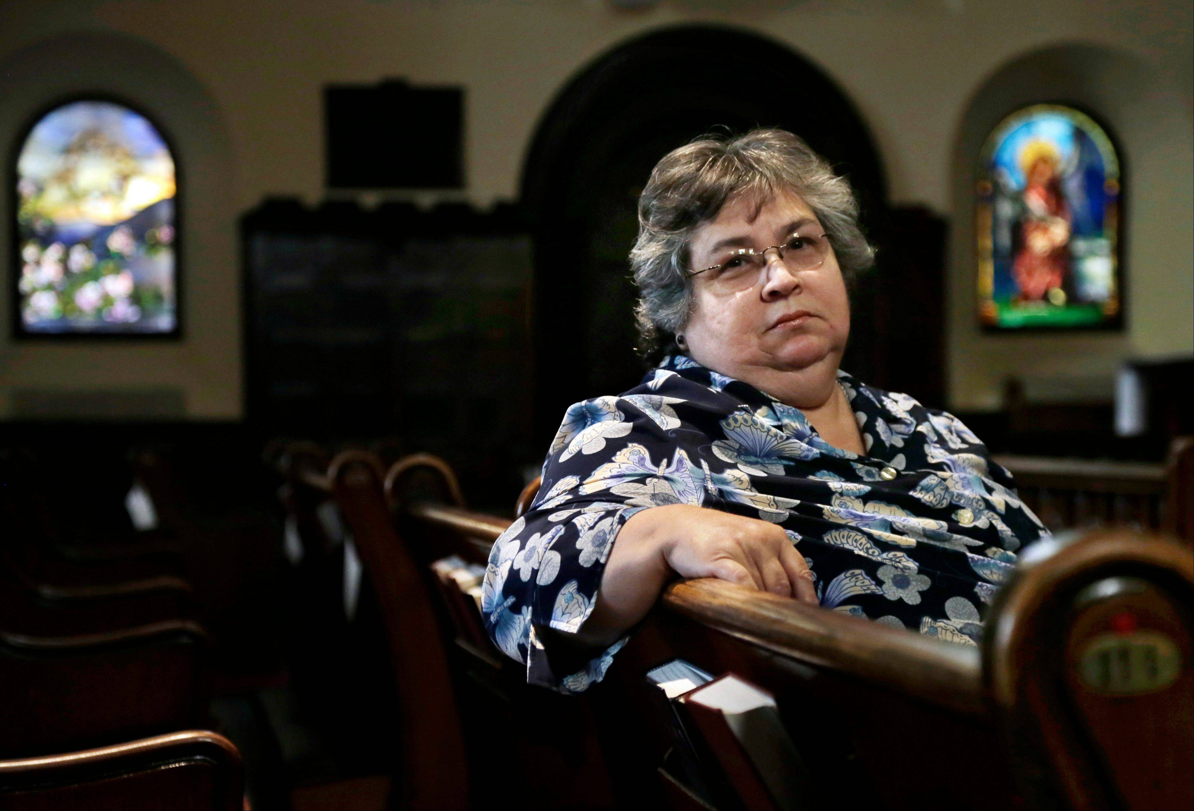 Armantina Pelaez, a former crisis counselor at St. Mary's Hospital, in Paterson, N.J., sits in Paterson's Saint Paul's Episcopal Church. The latest terms of the sale of the hospital appear to show that little more than half the pension obligation shortfall would be covered.