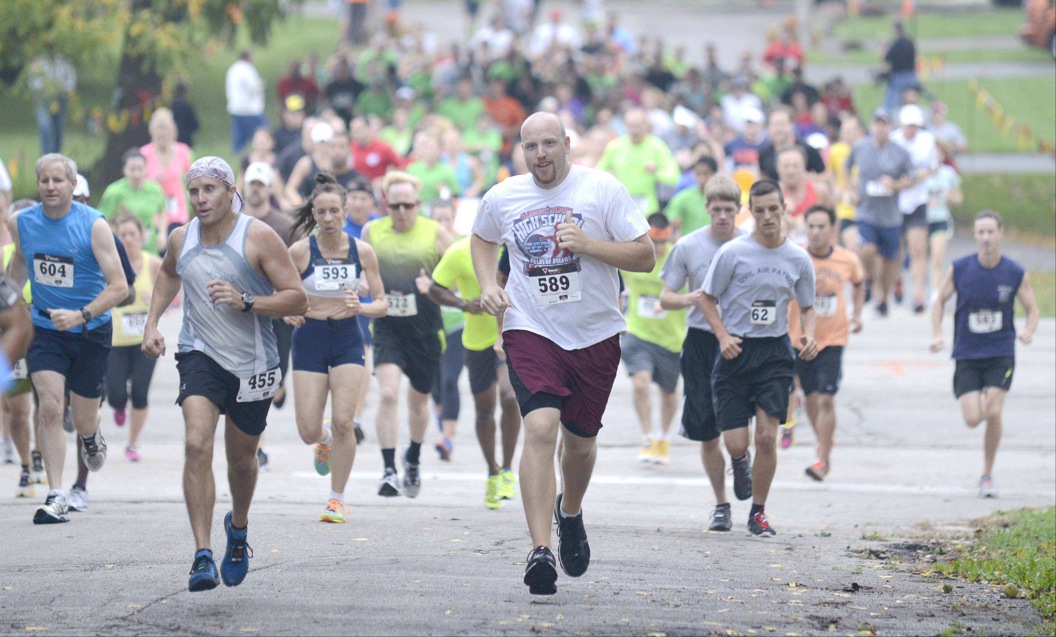 Runners take off in South Elgin Parks & Recreation FUNdation's ninth annual Harvest Hustle 7K Run and 2-Mile Walk on Saturday.