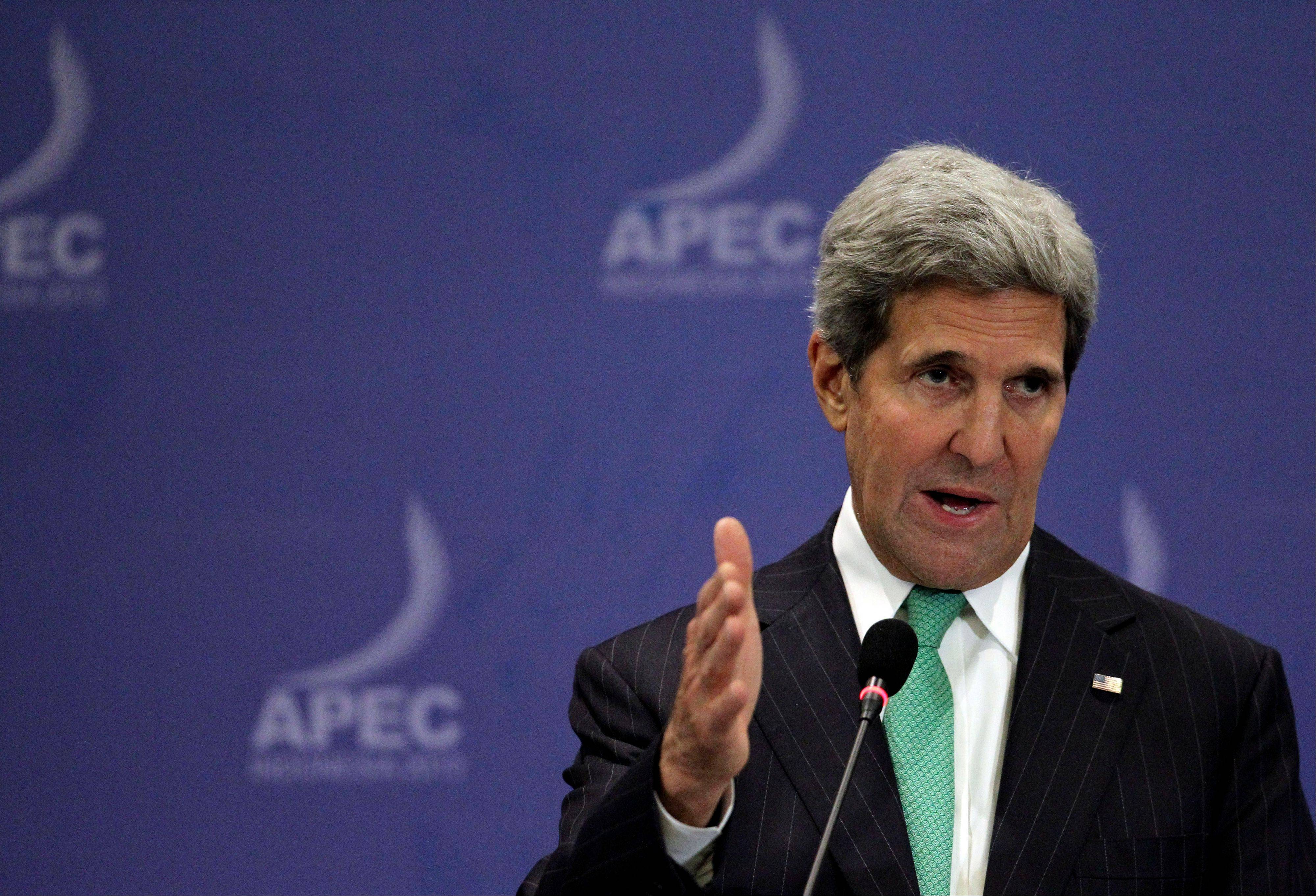 "U.S. Secretary of State John Kerry speaks during a news conference at the Asia-Pacific Economic Cooperation (APEC) summit in Bali, Indonesia, Saturday. Kerry on Saturday urged Congress to end the partial government shutdown and think ""long and hard"" about the message U.S. sends the world when ""we can't get our own act together."""
