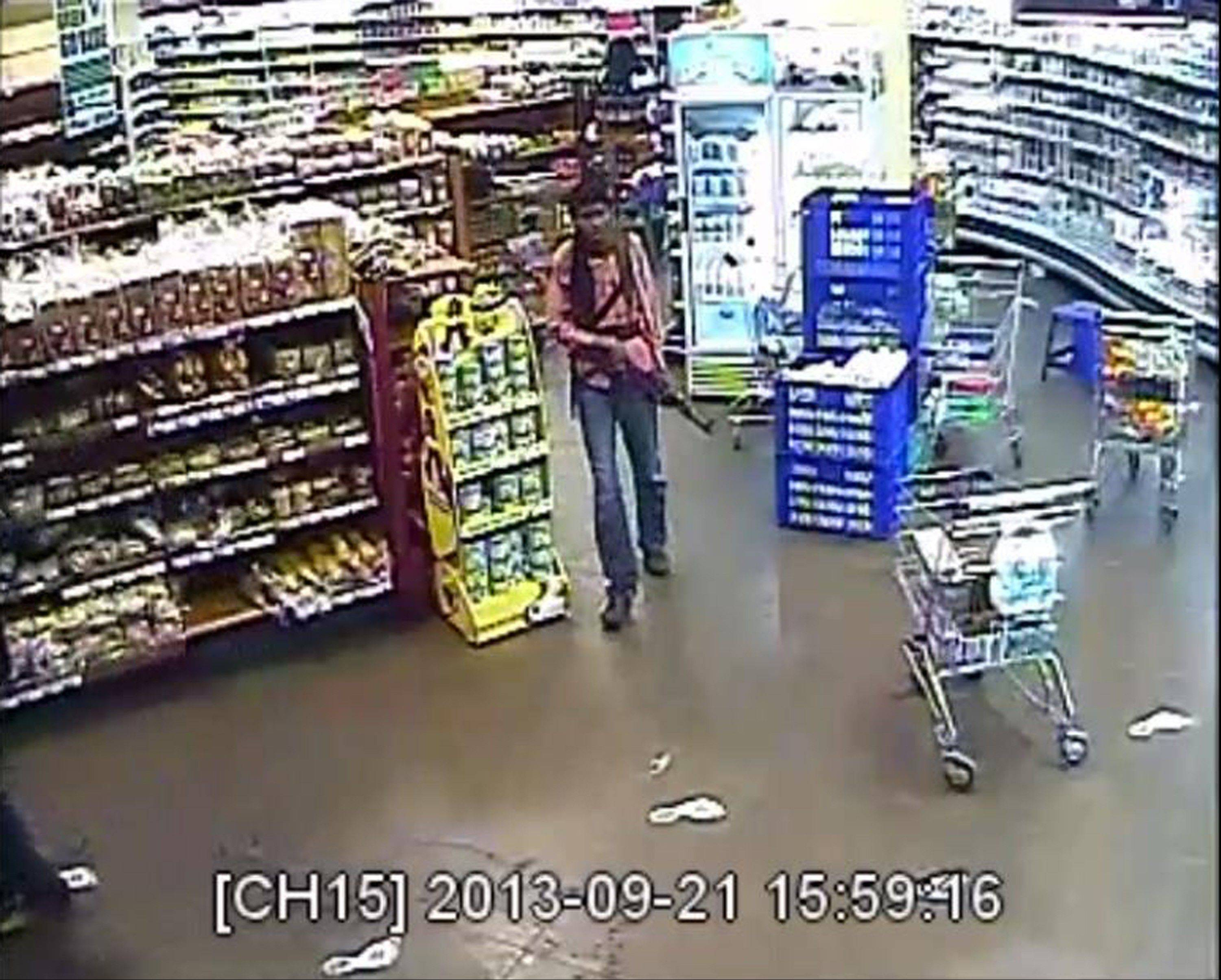 In this photo taken from footage from Citizen TV, via the Kenya Defence Forces and made available Friday, Oct. 4, a man reported to be Umayr, one of the four armed militants walking in a store at the Westgate Mall, during the four-day-long siege at the mall in Nairobi, Kenya that killed more than 60 people last month. A Kenyan military spokesman has confirmed the names of four attackers as Abu Baara al-Sudani, Omar Nabhan, Khattab al-Kene and Umayr.