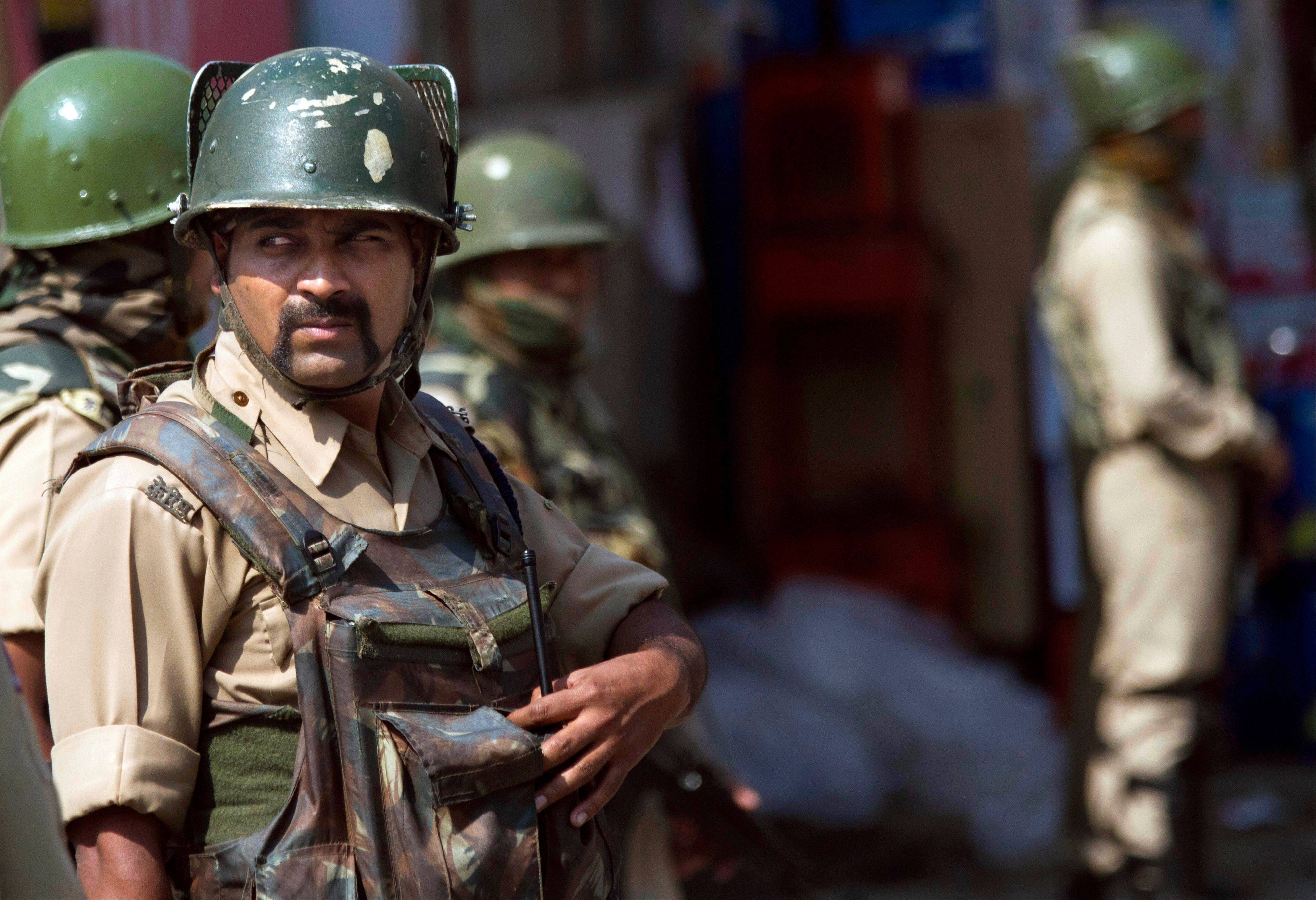 Associated Press Indian paramilitary soldiers stand guard in Srinagar, India, Saturday, Oct. 5. The Indian army said Saturday that it killed seven suspected rebels in two separate gunbattles near the heavily militarized line dividing the disputed Kashmir region between India and Pakistan.