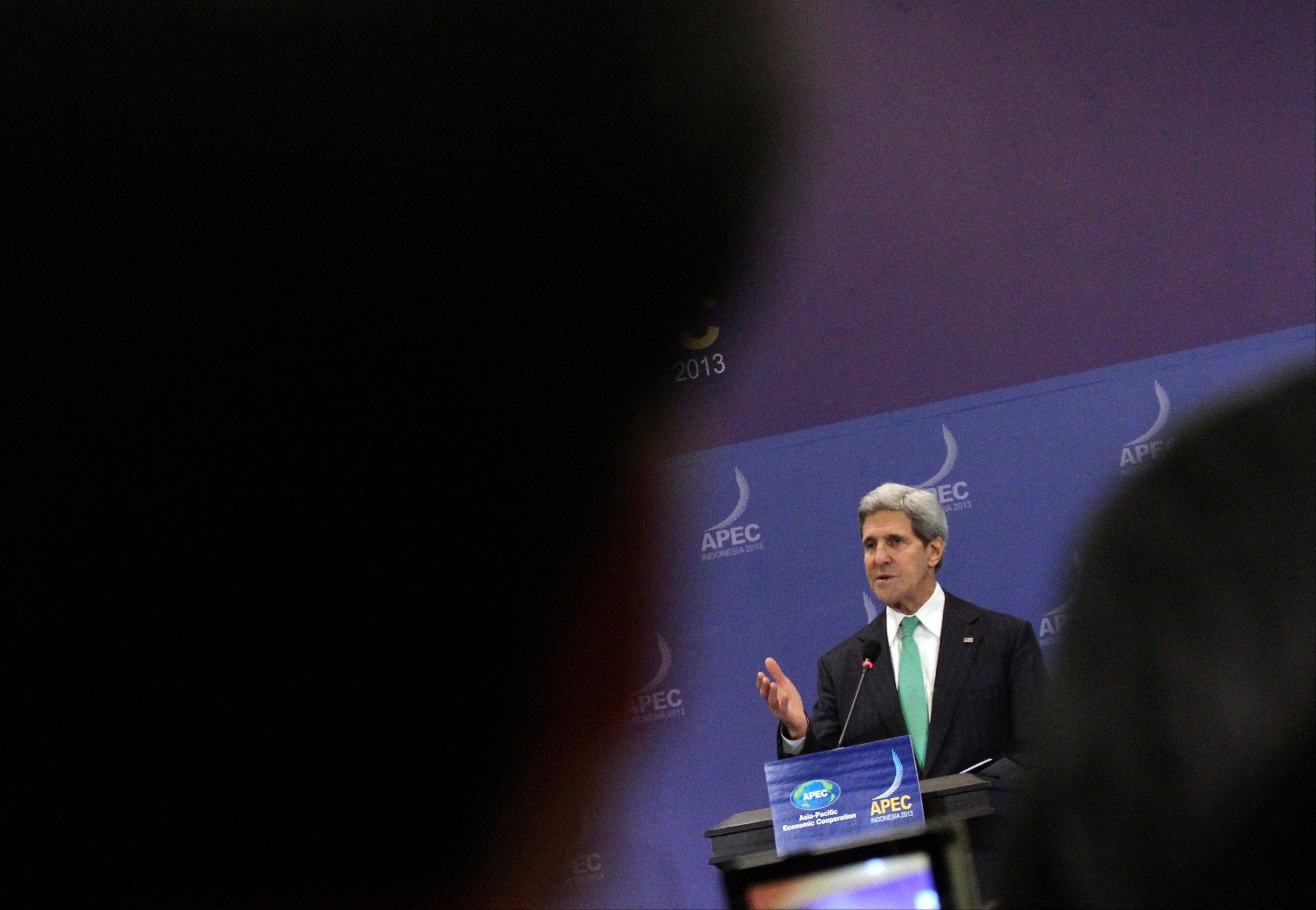 U.S. Secretary of State John Kerry speaks during a press conference at the Asia-Pacific Economic Cooperation ministerial meeting in Bali, Indonesia, Saturday, Oct. 5. Kerry said talks on a trans-Pacific trade pact are forging ahead despite U.S. President Barack Obama's absence due to the government shutdown.