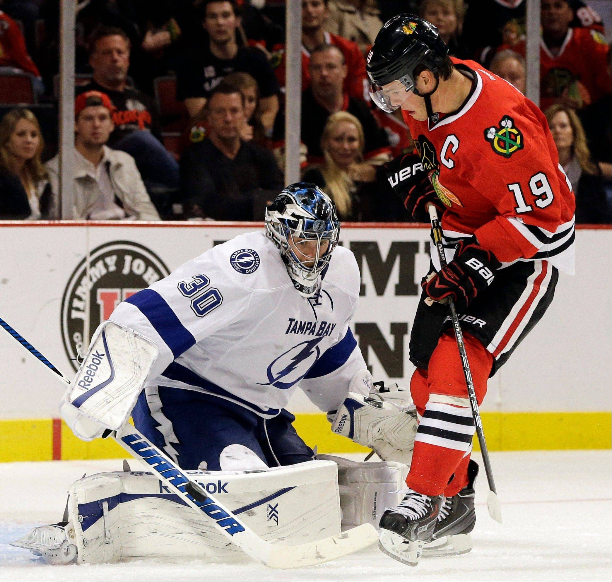 Lightning goalie Ben Bishop blocks a shot by the Blackhawks� Jonathan Toews during the second period Saturday night at the United Center.