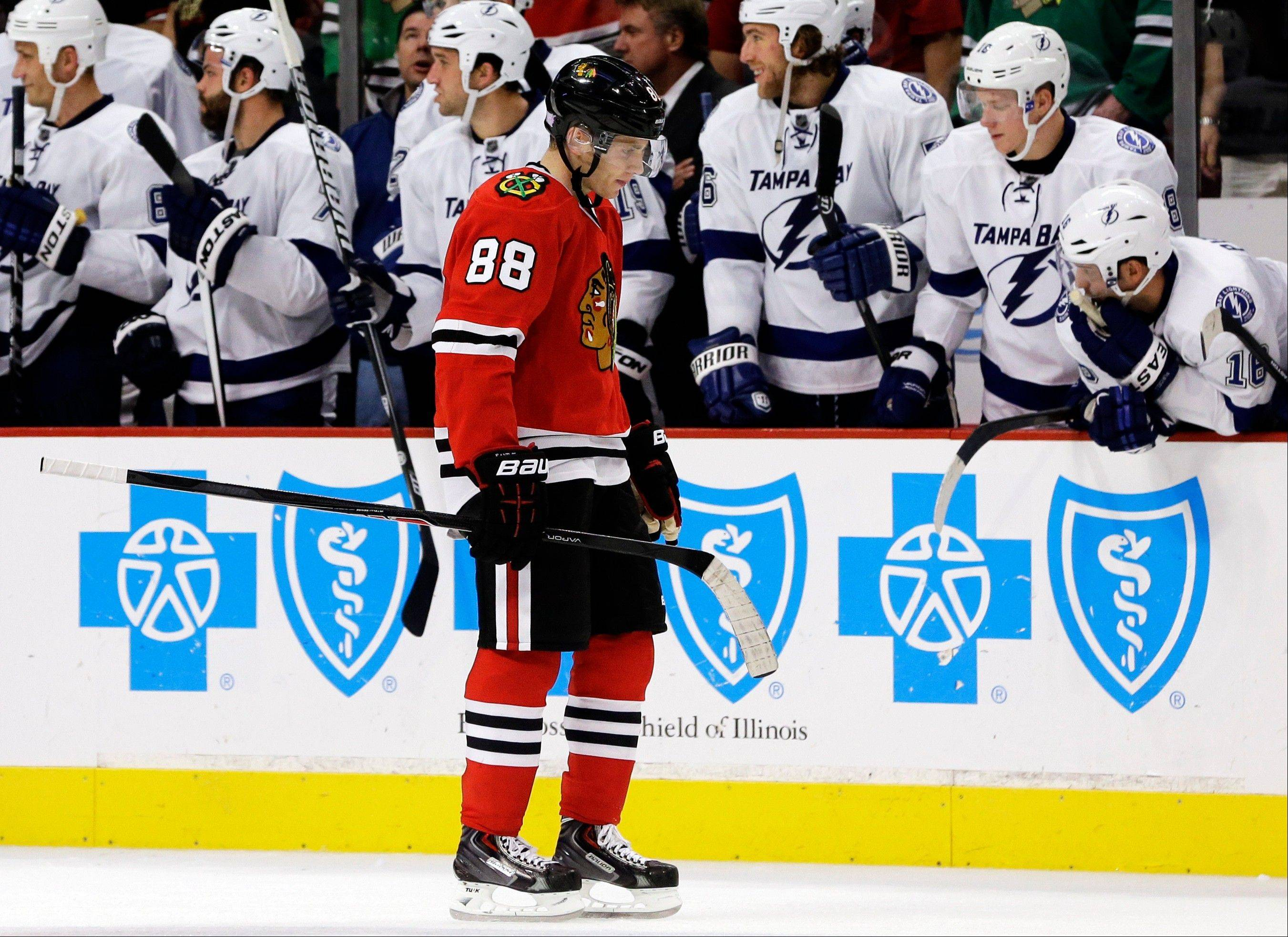 Chicago Blackhawks' Patrick Kane skates to bench after missing a shot against the Tampa Bay Lightning during the shootout of an NHL hockey game in Chicago, Saturday, Oct. 5, 2013. The Lightning won 3-2. (AP Photo/Nam Y. Huh)