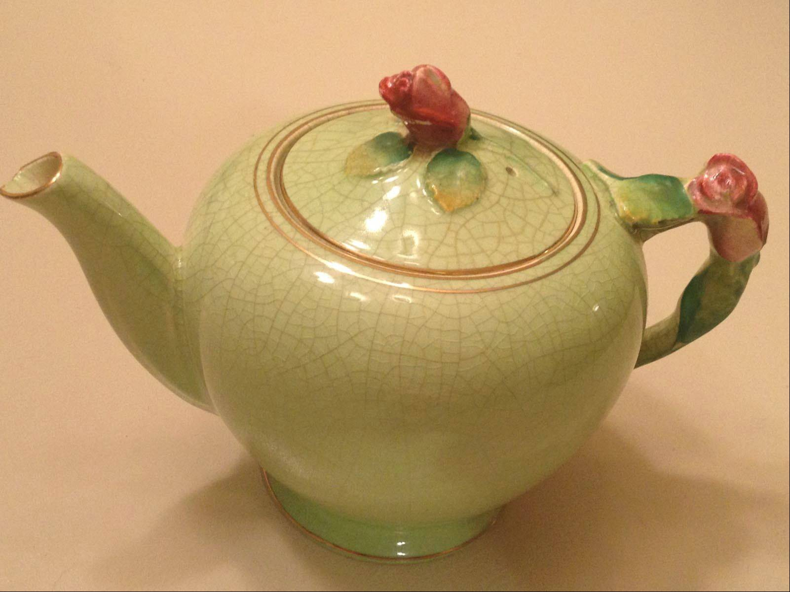 Pretty red roses and a crackle celadon-green glaze make this Royal Winton teapot a charmer.