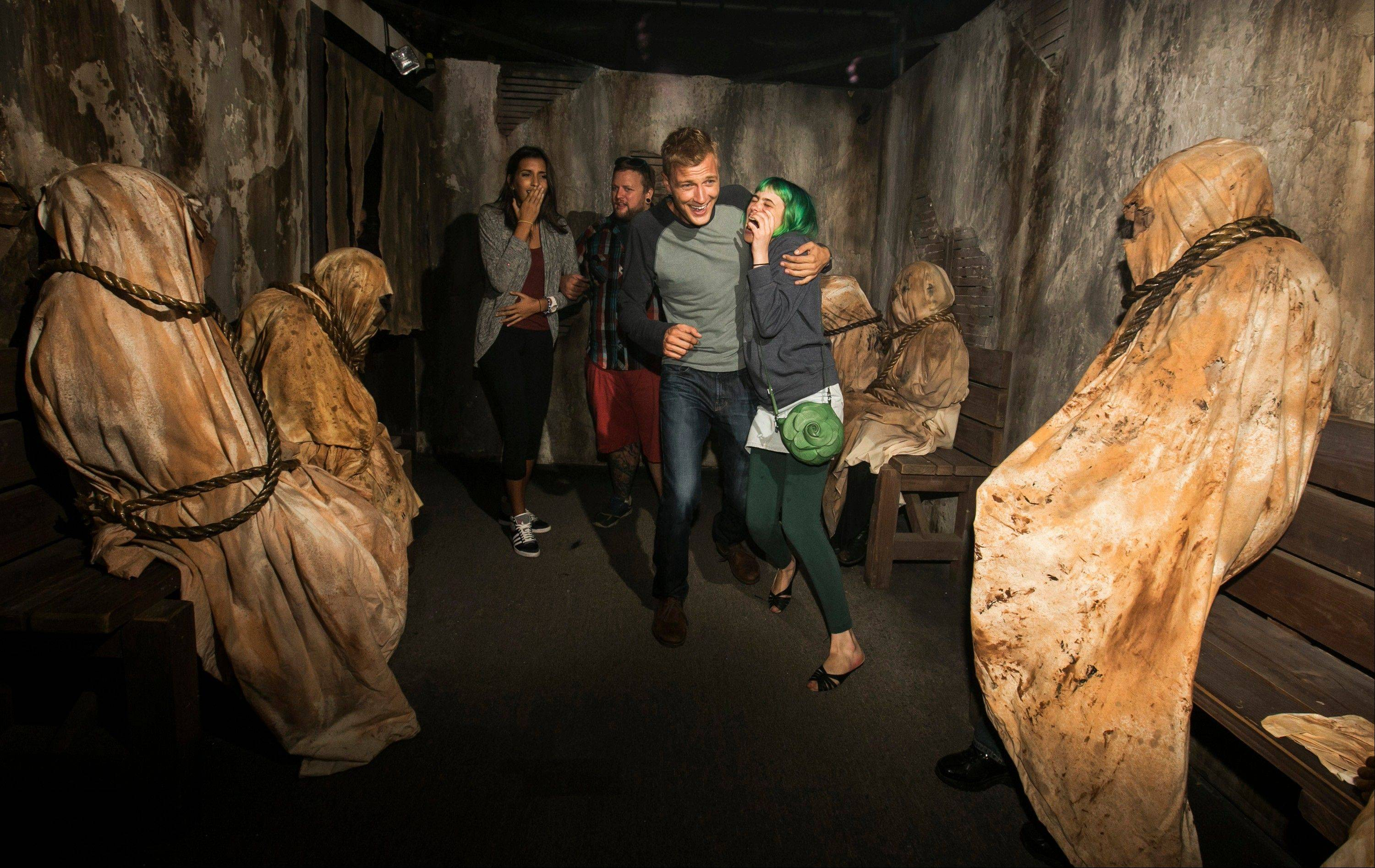 "Guests experience the ""Insidious: Into the Further"" maze based on the movie ""Insidious: Chapter 2"" during Halloween Horror Nights at Universal Studios Hollywood in Universal City, Calif."