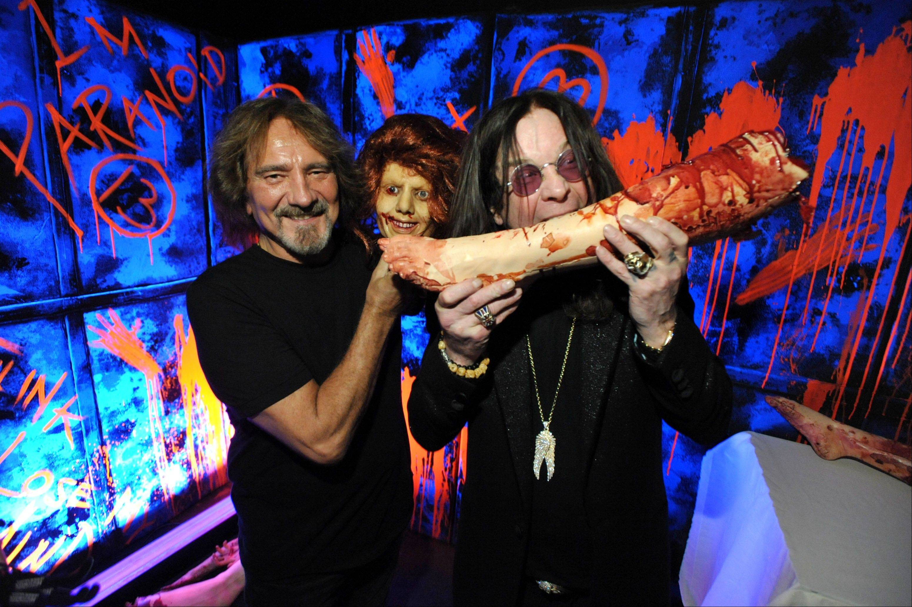 "While on a behind-the-scenes trek through a Universal Studios Hollywood attraction based on the recently released Black Sabbath album ""13,"" Ozzy Osbourne, right, and Geezer Butler have a little fun with some props."