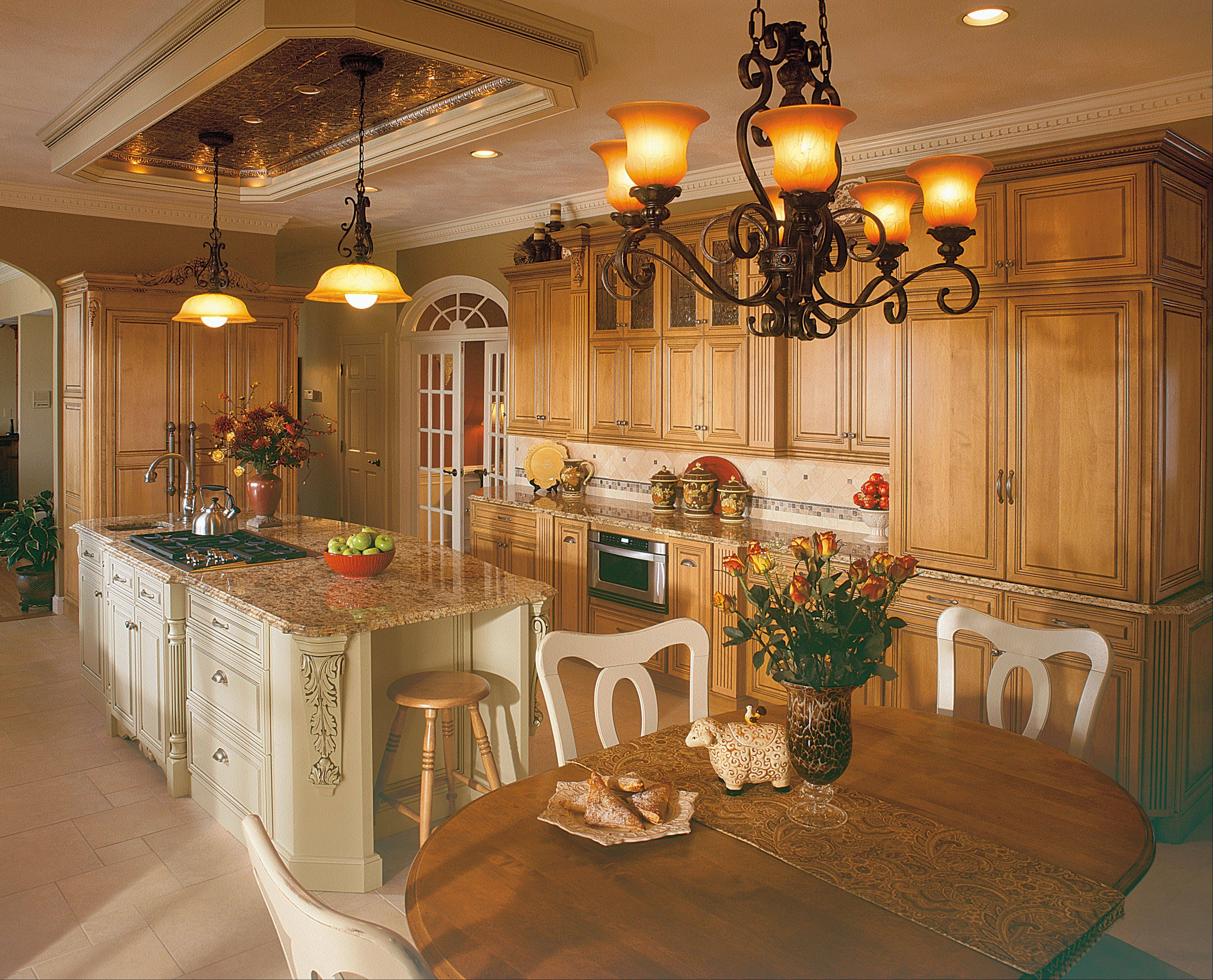 Homeowners who are embarking on kitchen renovations are generally choosing taller cabinets that extend all the way to the ceiling with fancy moldings.