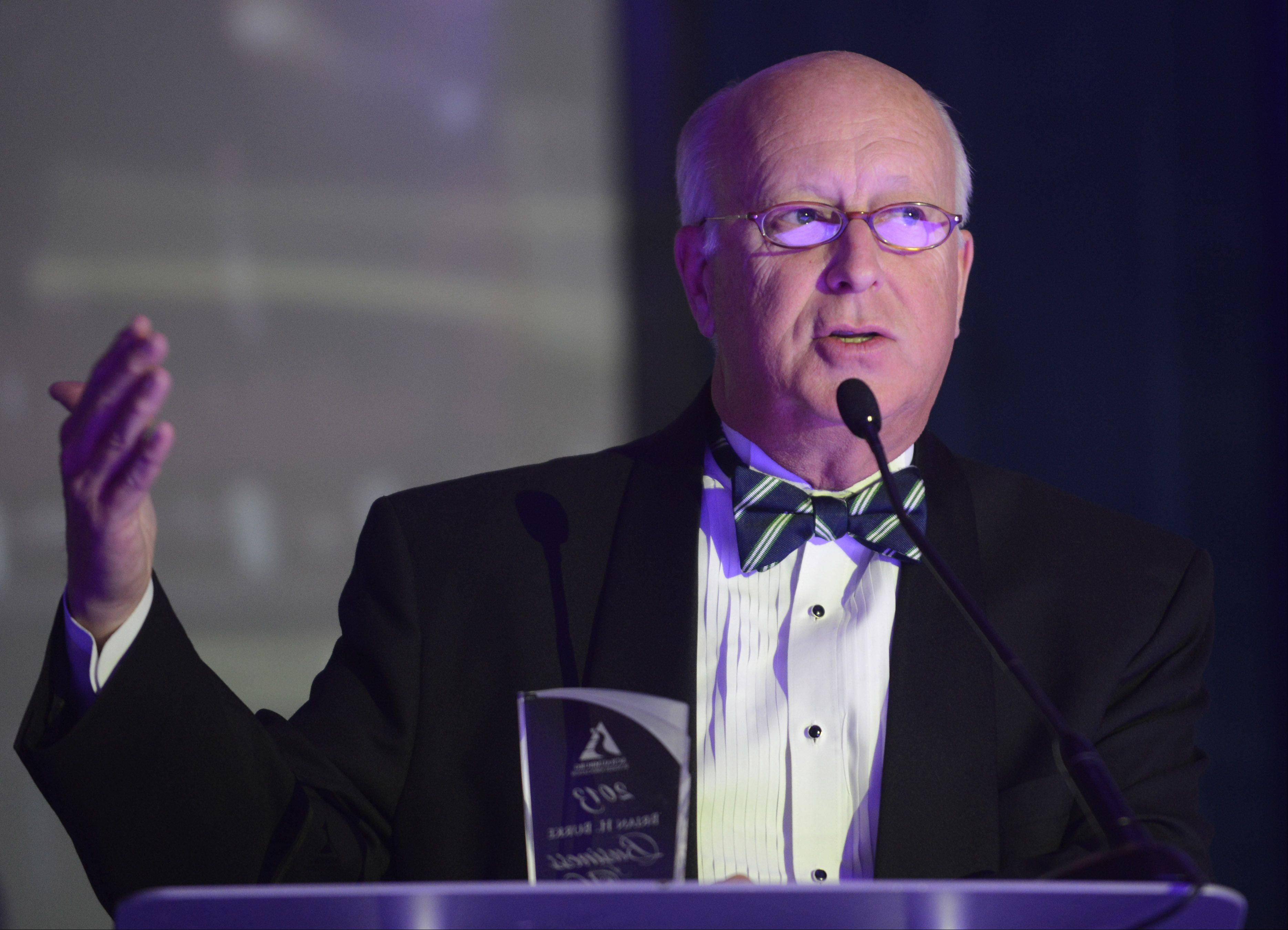 Douglas K. Ray, CEO and publisher of the Daily Herald Media Group, accepts the Brian H. Burke Business of the Year Award during the Schaumburg Business Association Toast of Schaumburg event Saturday at the Renaissance Schaumburg Convention Center.