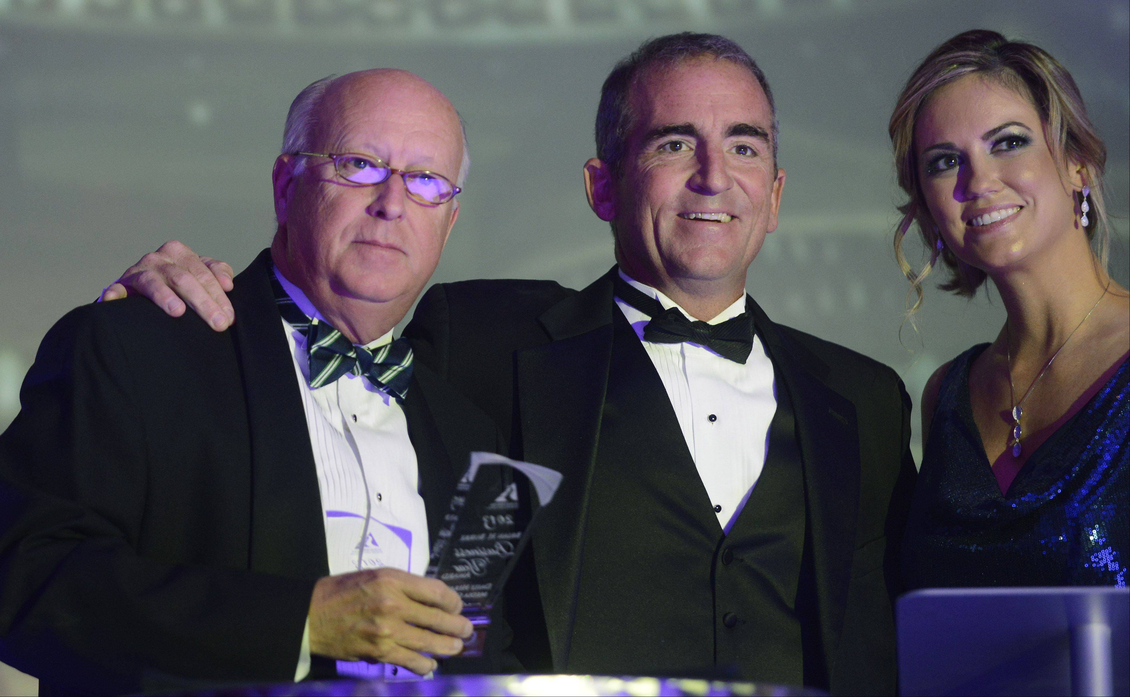 JOE LEWNARD/jlewnard@dailyherald.comDouglas K. Ray, CEO and publisher of the Daily Herald Media Group, stands with Jim Burke of Links and Kaili Harding, president of the Schaumburg Business Association, as he accepts the Brian H. Burke Business of the Year Award during the Schaumburg Business Association Toast of Schaumburg event Saturday at the Renaissance Schaumburg Convention Center.