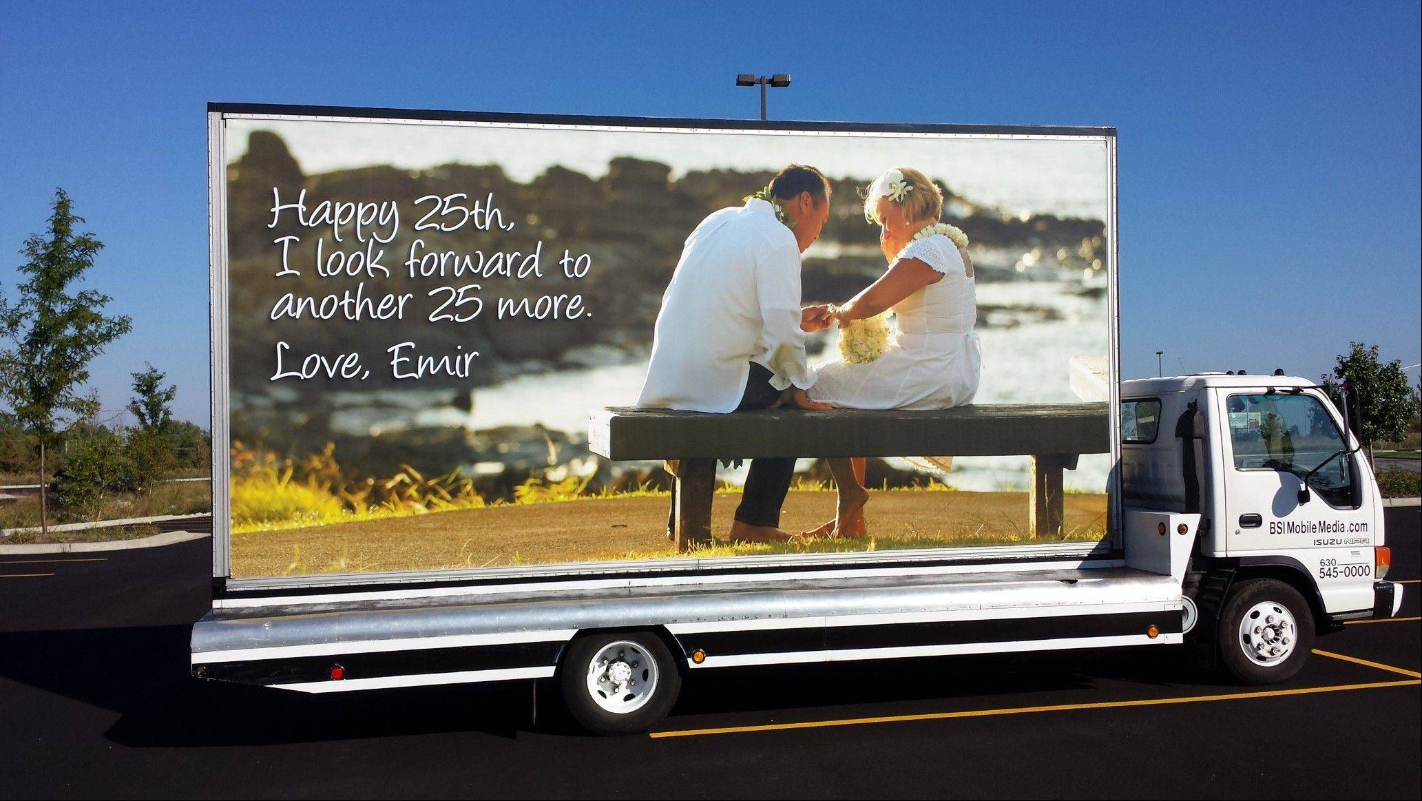Emir Abinion, who owns a car dealership in St. Charles, celebrated his 25th wedding anniversary with his wife, Pat, with a nice dinner and ... a two-sided traveling billboard.