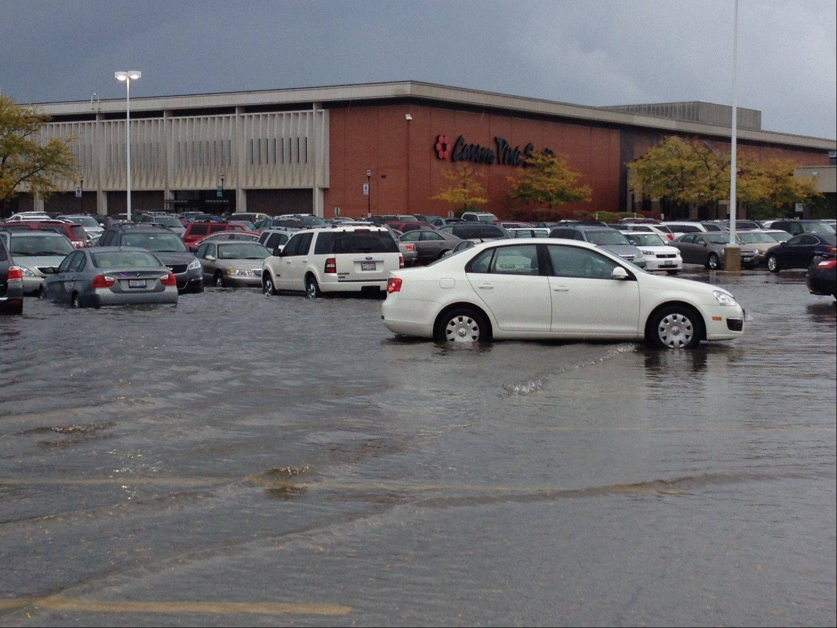 Water from Saturday's rain came up to the bottom of some of the cars in the parking lot at Yorktown Center in Lombard.