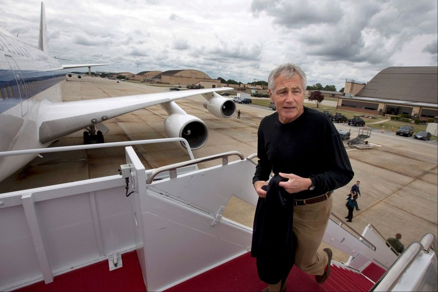 In this Sept. 28 file photo U.S. Secretary of Defense Chuck Hagel boards his plane at Andrews Air Force Base, Md., en route to South Korea. The Pentagon ordered most of its approximately 400,000 furloughed civilian employees back to work. The decision by Hagel is based on a Pentagon legal interpretation of a law called the Pay Our Military Act.