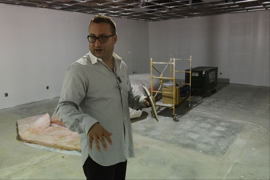 Marc Portugal shows a room under construction at the new GiGi's Playhouse National Achievement Center in Hoffman Estates Friday.