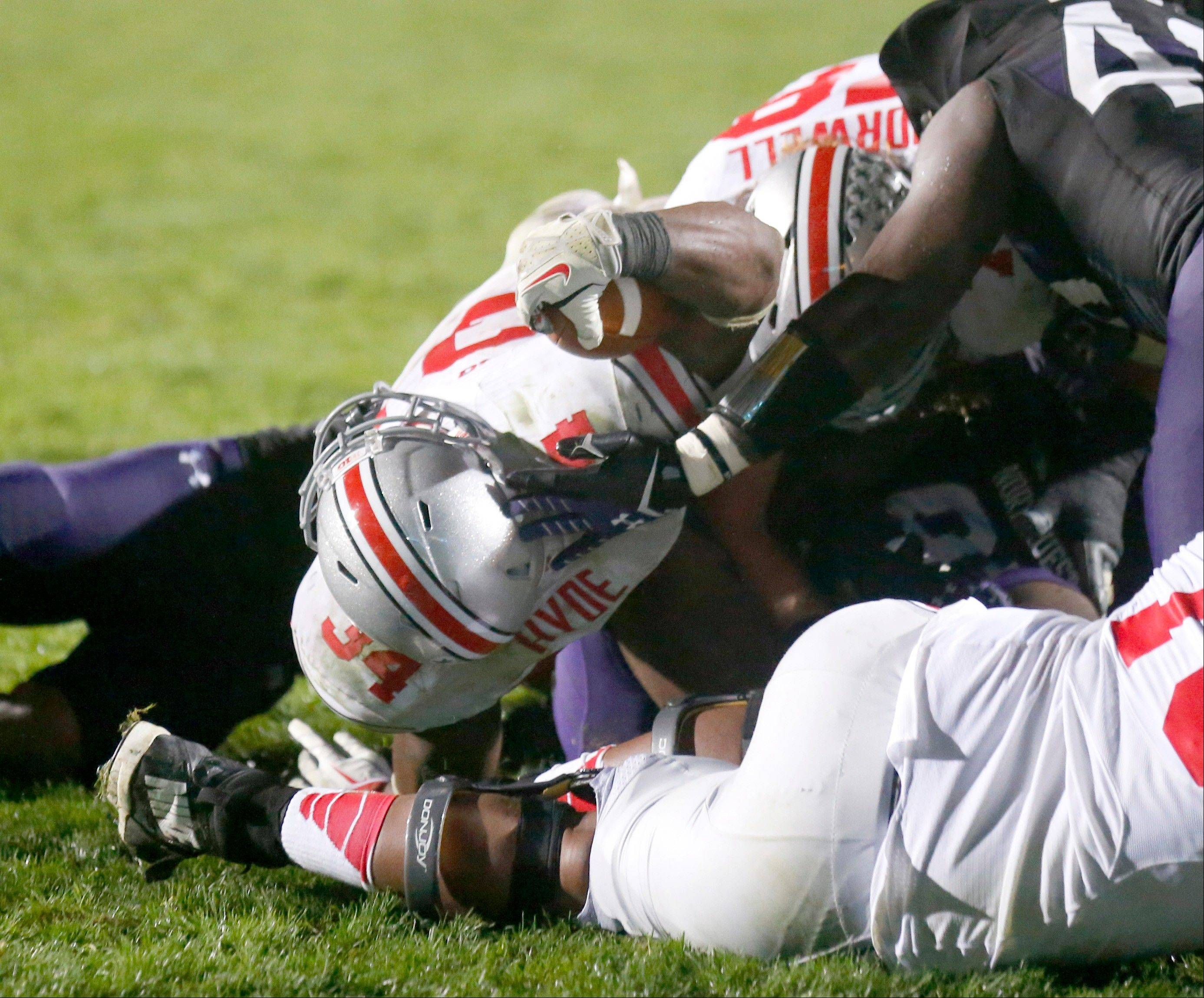 Ohio State running back Carlos Hyde stretches the ball over the goal line for a touchdown, as determined by video review, in the fourth quarter Saturday night against Northwestern.