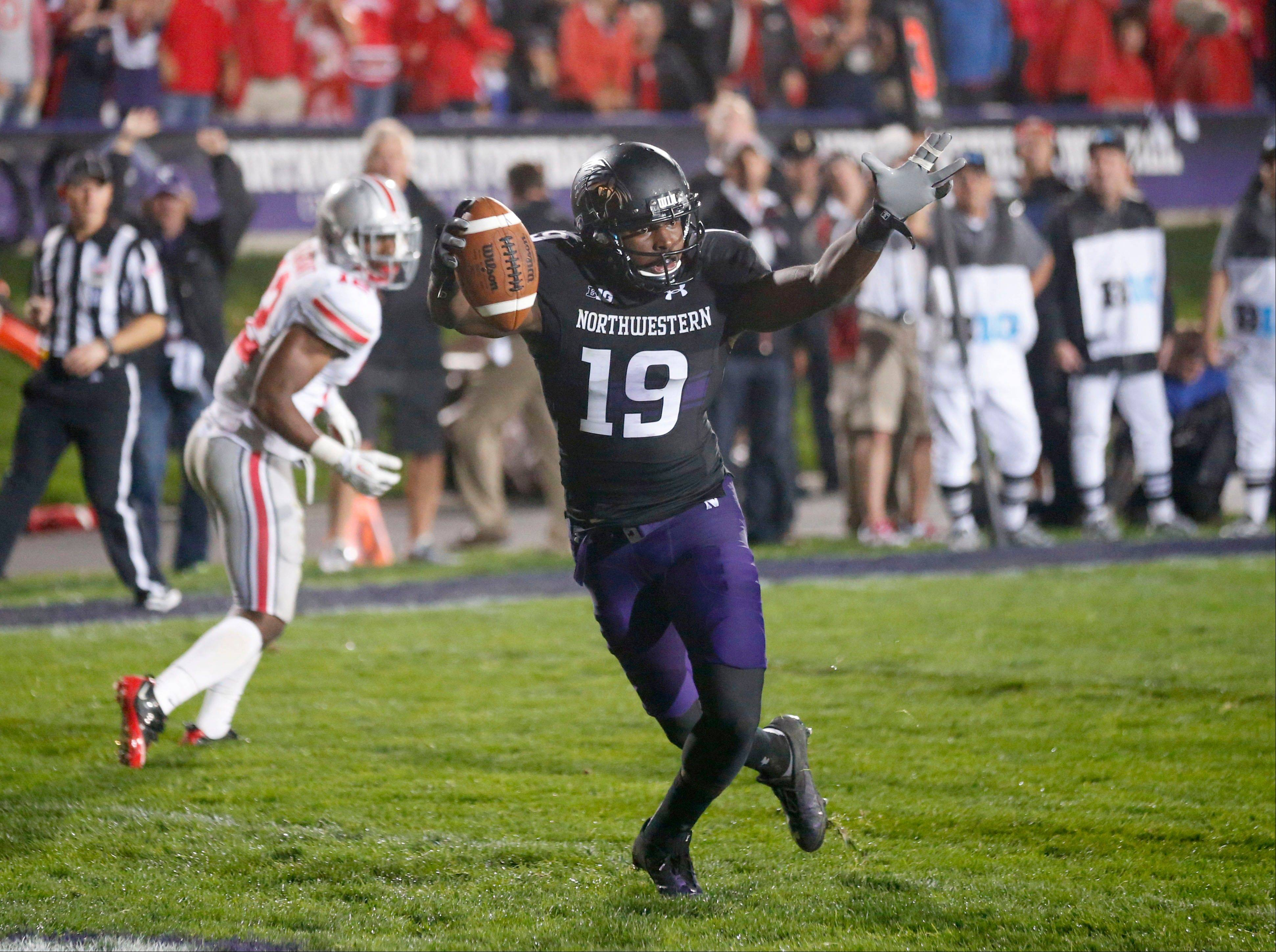 Northwestern wide receiver Cameron Dickerson (19) celebrates his touchdown on a pass from quarterback Trevor Siemian during Saturday's game in Evanston. Ohio State won 40-30.