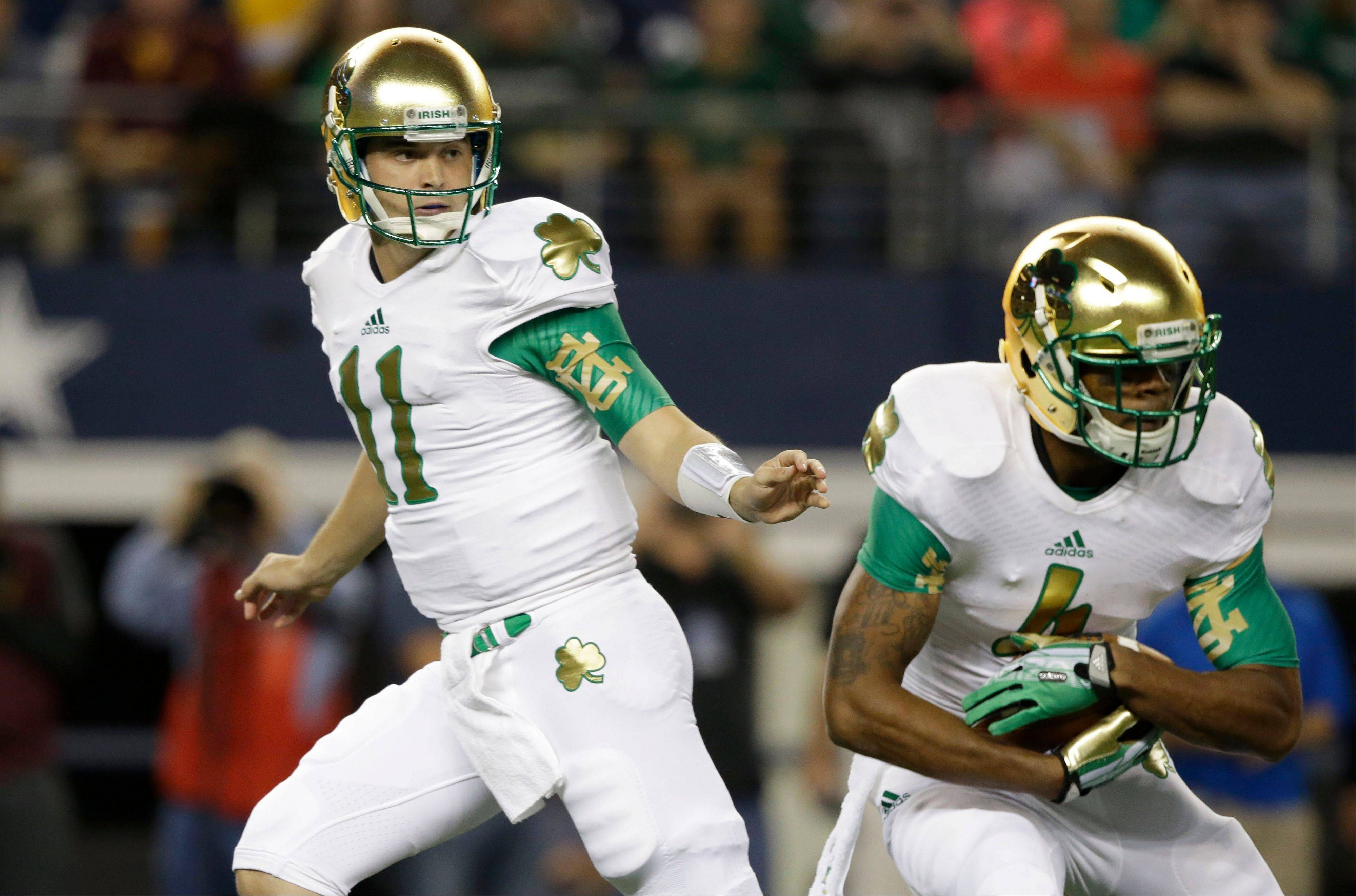 Notre Dame quarterback Tommy Rees (11) hands off to running back George Atkinson III during the first half of an NCAA college football game against Arizona State on Saturday, Oct. 5, 2013, in Arlington, Texas.