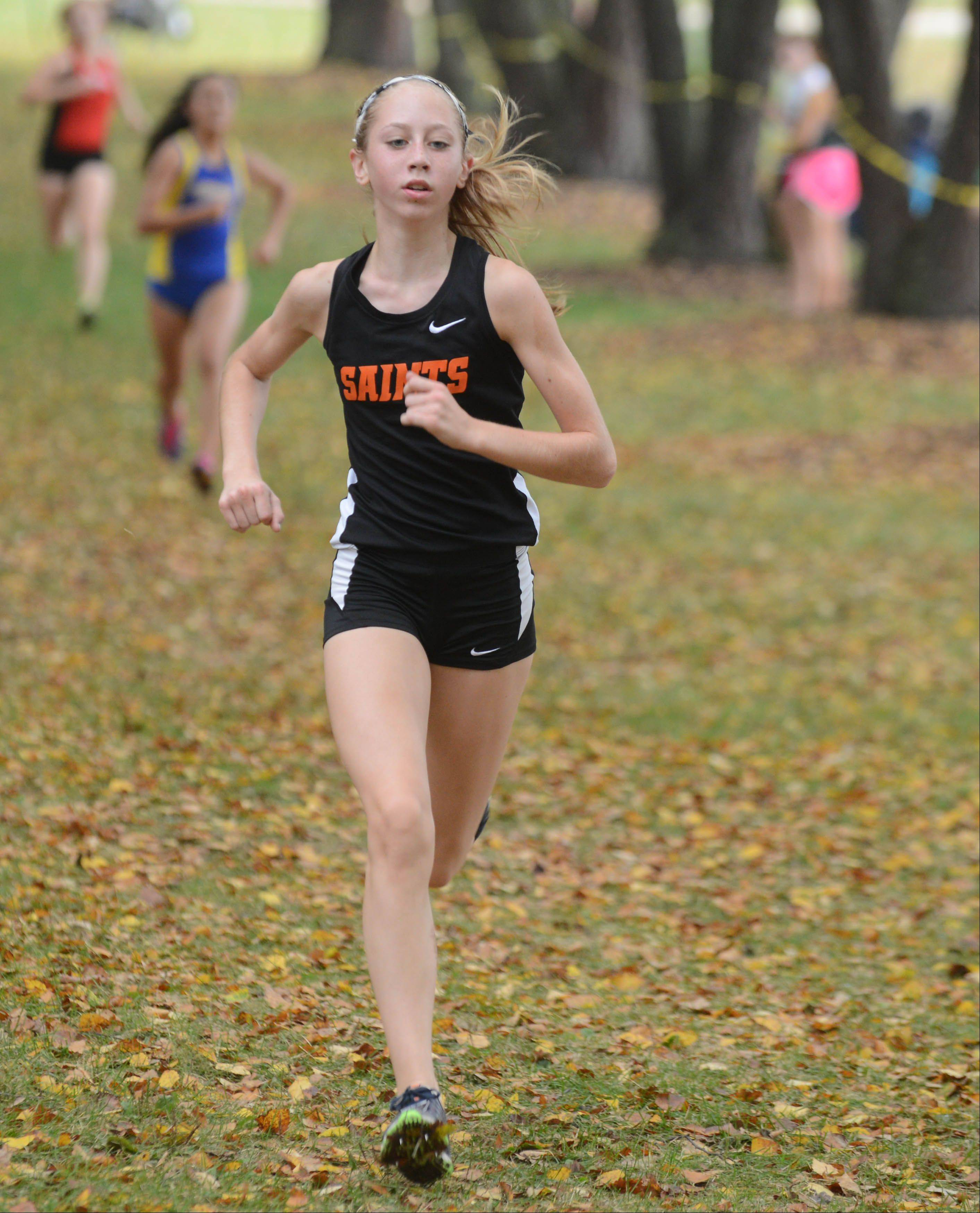 Lauren Woelffer of St. Charles East took part in the Wheaton North girls cross country invitational Saturday in Wheaton.