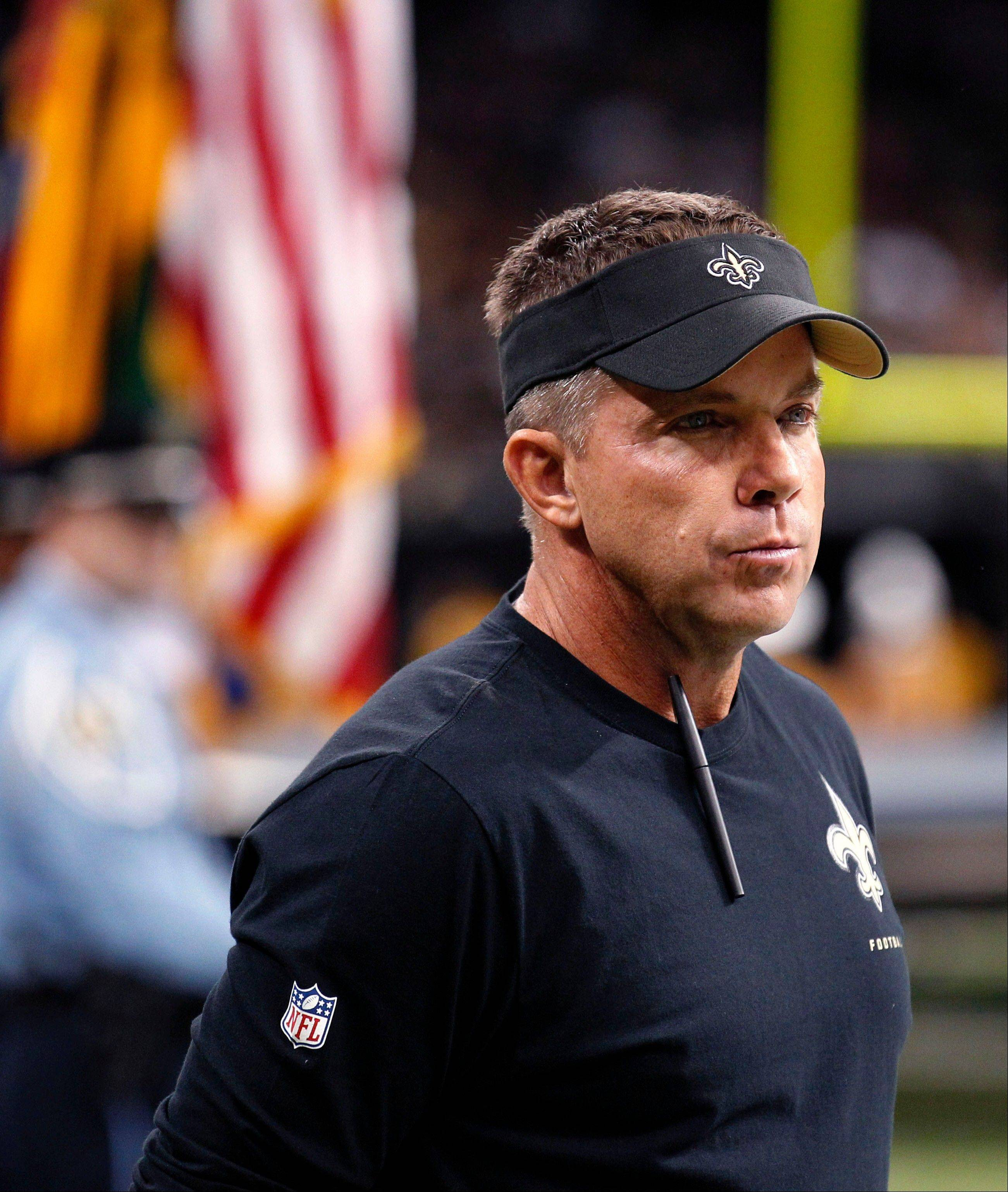New Orleans Saints head coach Sean Payton watches introductions from the sideline before an NFL football game against the Atlanta Falcons in New Orleans, Sunday, Sept. 8, 2013. The Saints won 23-17.