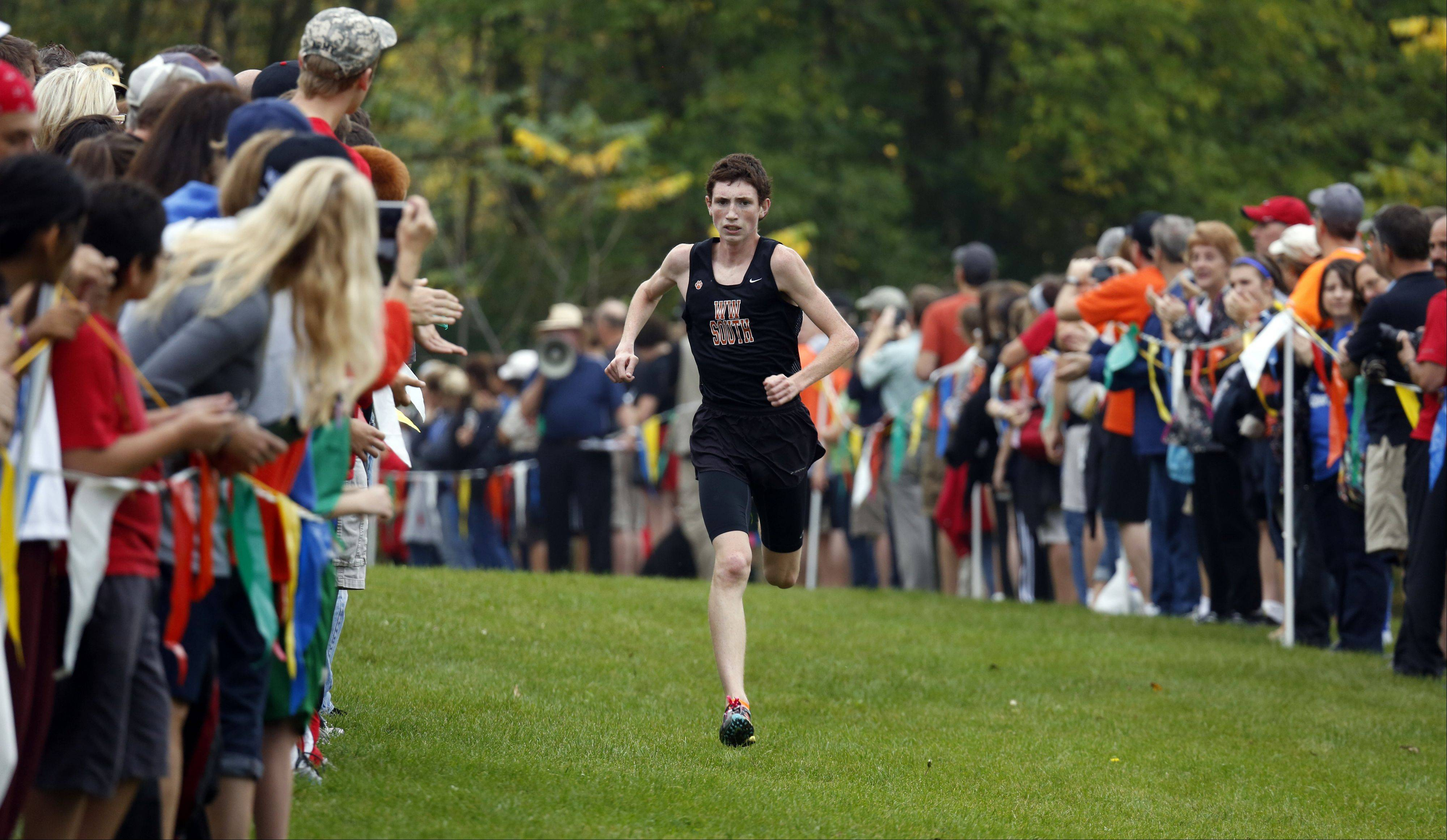 Wheaton Warrenville South's Nolan McKenna makes his way to first place during boys cross country at LeRoy Oakes in St. Charles Saturday.