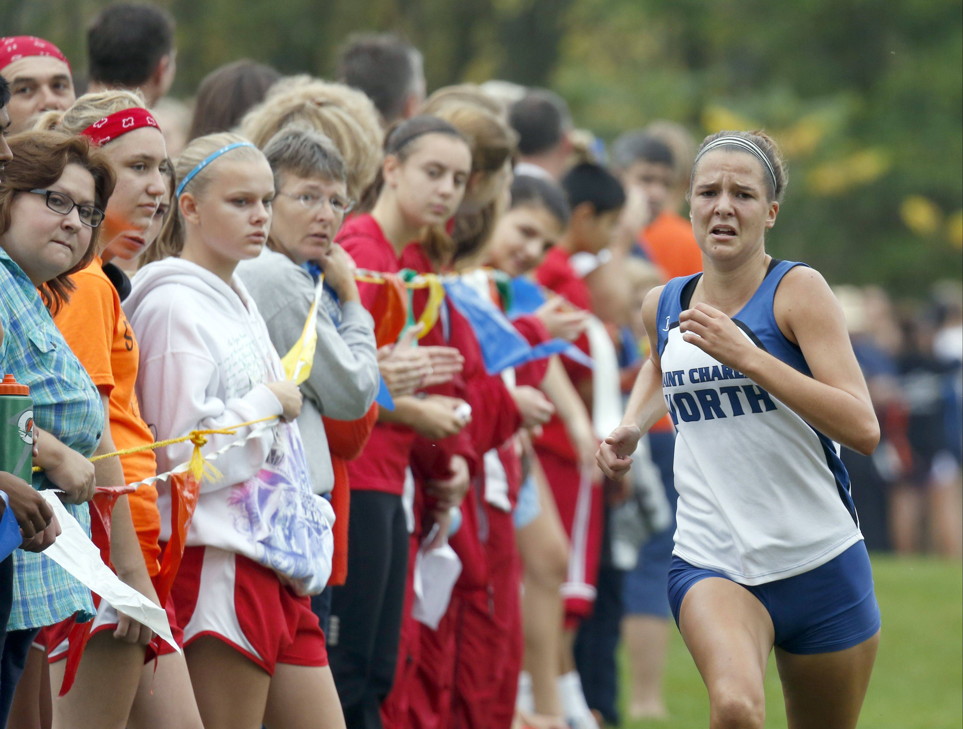 St. Charles North's Ashley England on her way to third during girls cross country at LeRoy Oakes in St. Charles Saturday.