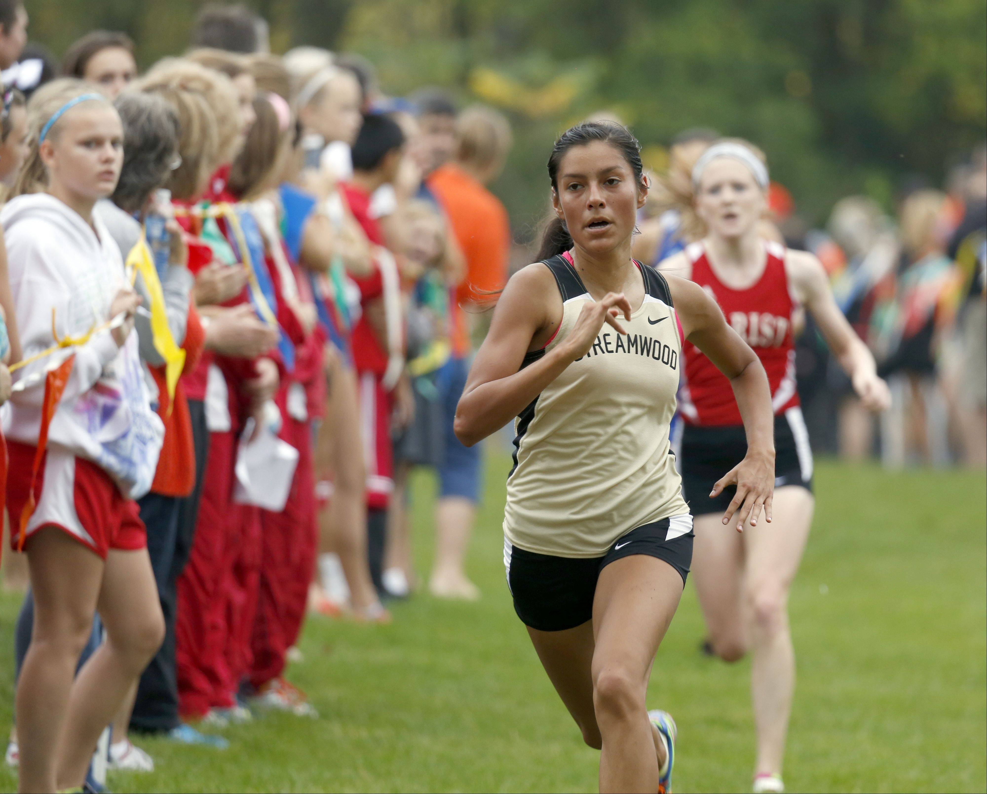 Streamwood's Gabby Juarez headed to 5th place during girls cross country at LeRoy Oakes in St. Charles Saturday.
