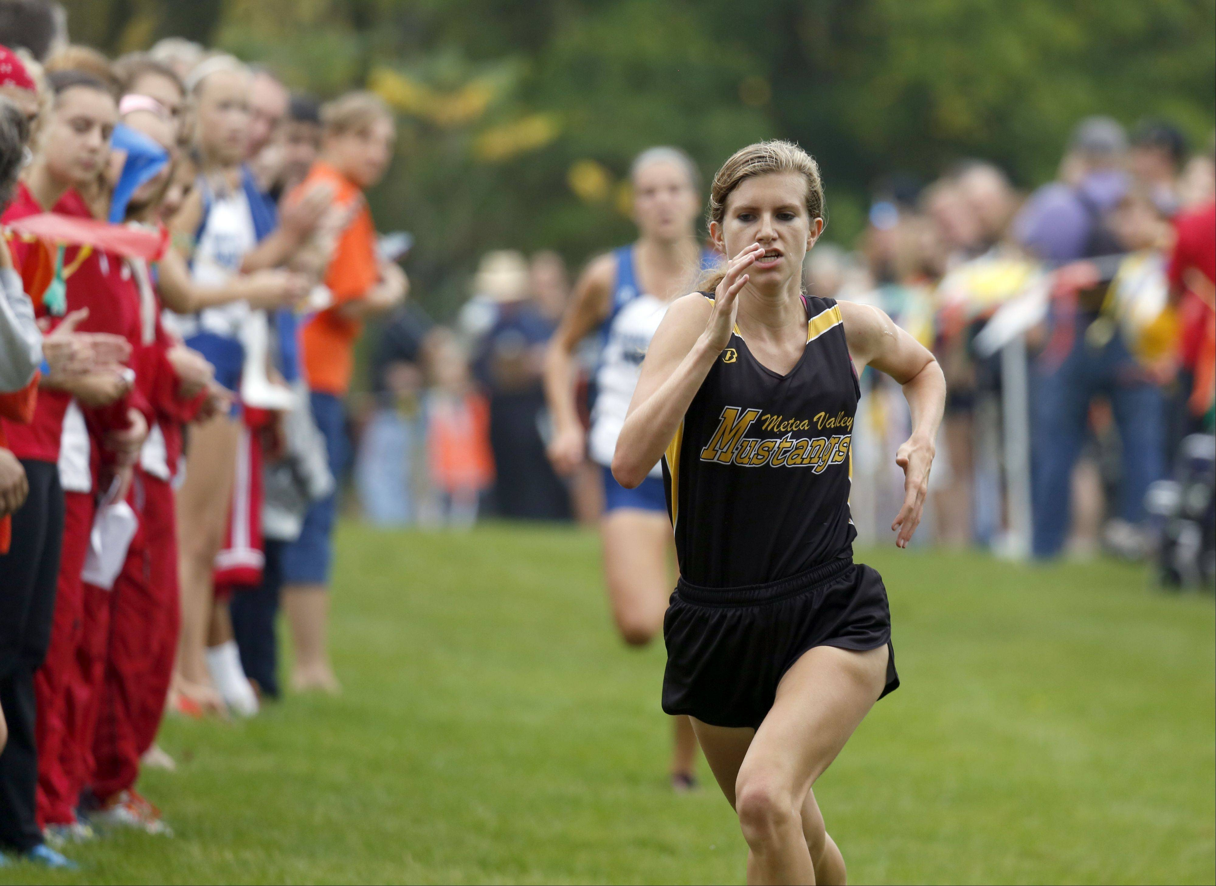Metea Valley's Kendall Cast heading to second during girls cross country at LeRoy Oakes in St. Charles Saturday.