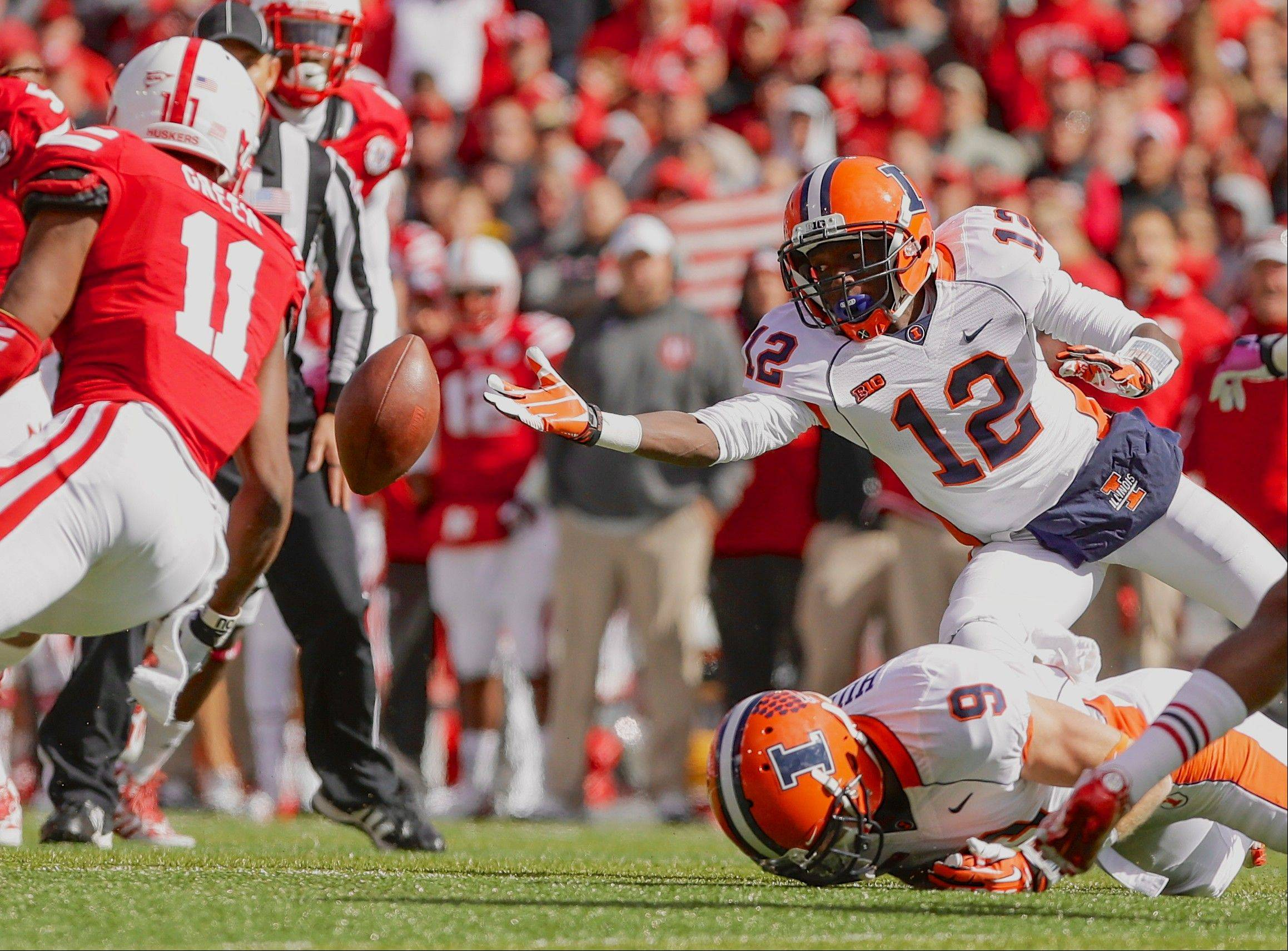 Illinois wide receiver Ryan Lankford (12) and Nebraska defensive back Andrew Green (11) reach out for a ball intended for Illinois wide receiver Steve Hull (9), which was knocked away by Nebraska cornerback Stanley Jean-Baptiste, not shown, in the first half.