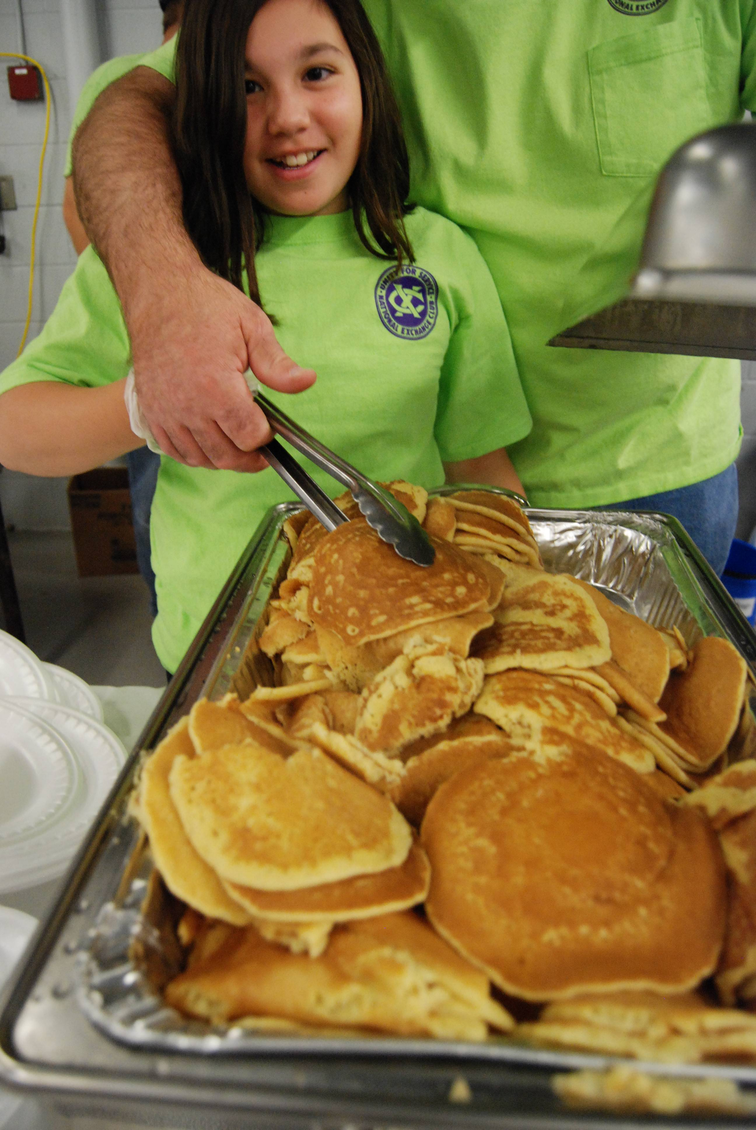 Everyone pitches in to help serve the best pancakes in Lake County