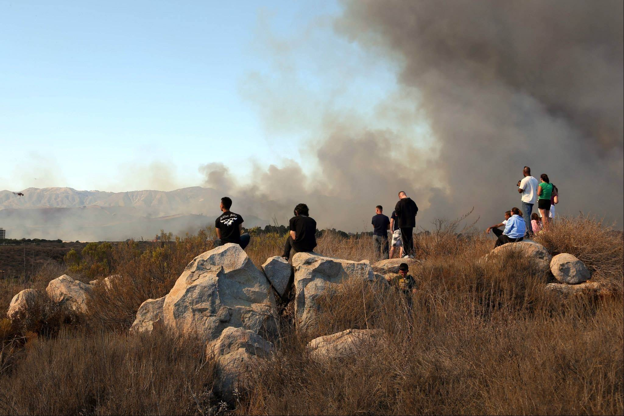 A fire burns in the Lake O�Neill vicinity of Camp Pendleton, Calif. This brush fire at Camp Pendleton has burned more than 1,500 acres and forced evacuation of a military housing area and the base hospital.