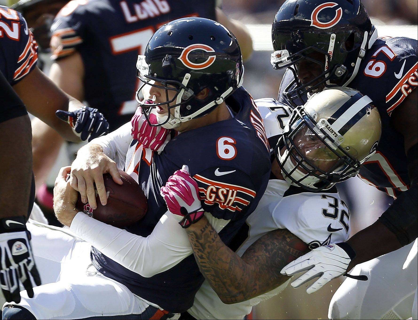 Chicago Bears quarterback Jay Cutler is sacked by New Orleans Saints strong safety Kenny Vaccaro during the Bears 26-18 loss Sunday at Soldier Field in Chicago.