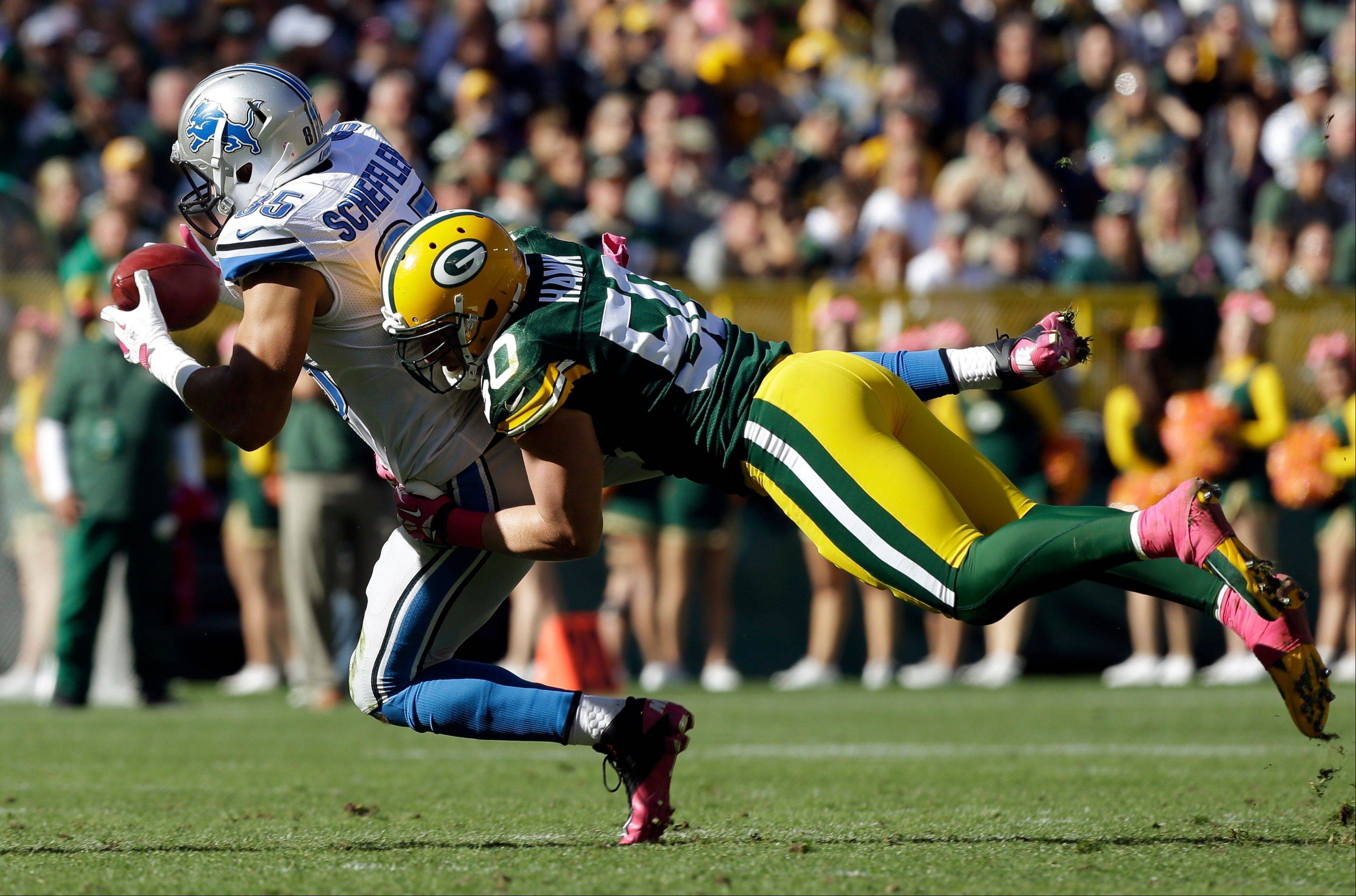 Associated Press Detroit Lions� Tony Scheffler catches a pass in front of Green Bay Packers� A.J. Hawk (50) during the second half of an NFL football game Sunday, Oct. 6, 2013, in Green Bay, Wis. The Packers won 22-9.