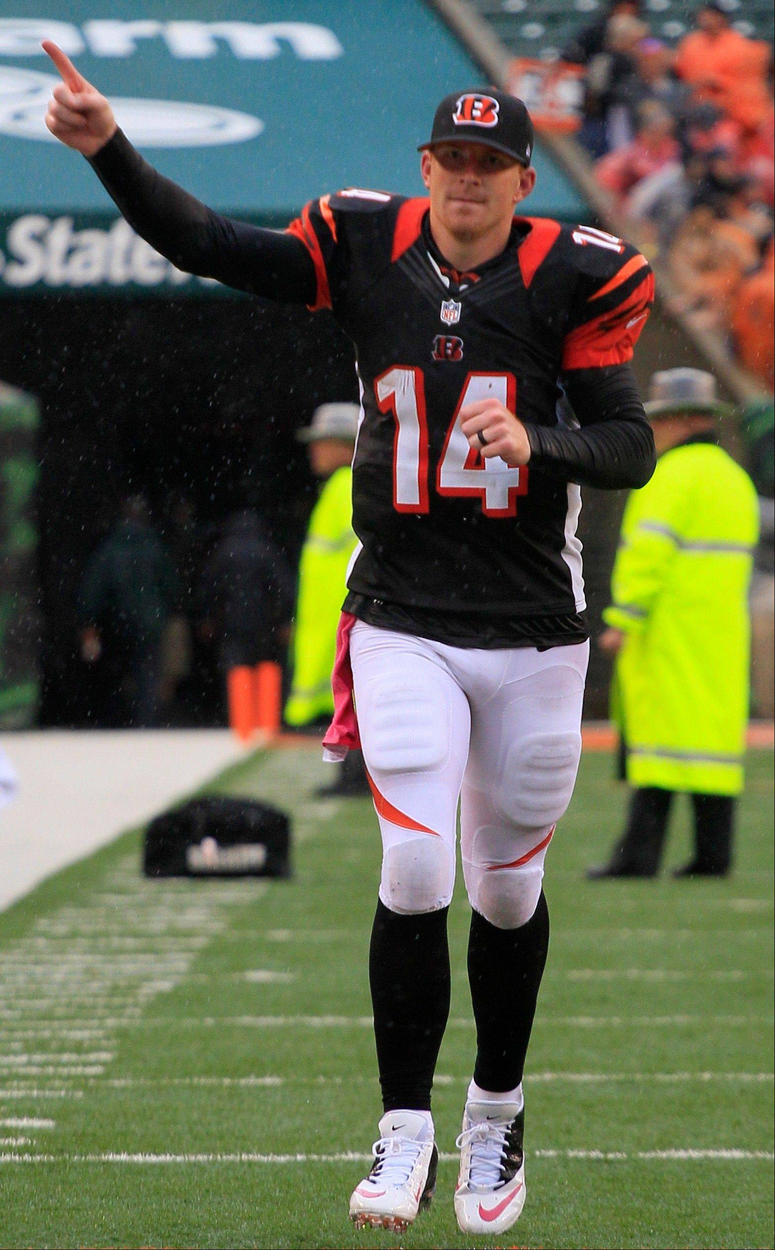 Cincinnati Bengals quarterback Andy Dalton runs off the field after the Bengals defeated the New England Patriots 13-6 in an NFL football game on Sunday, Oct. 6, 2013, in Cincinnati.