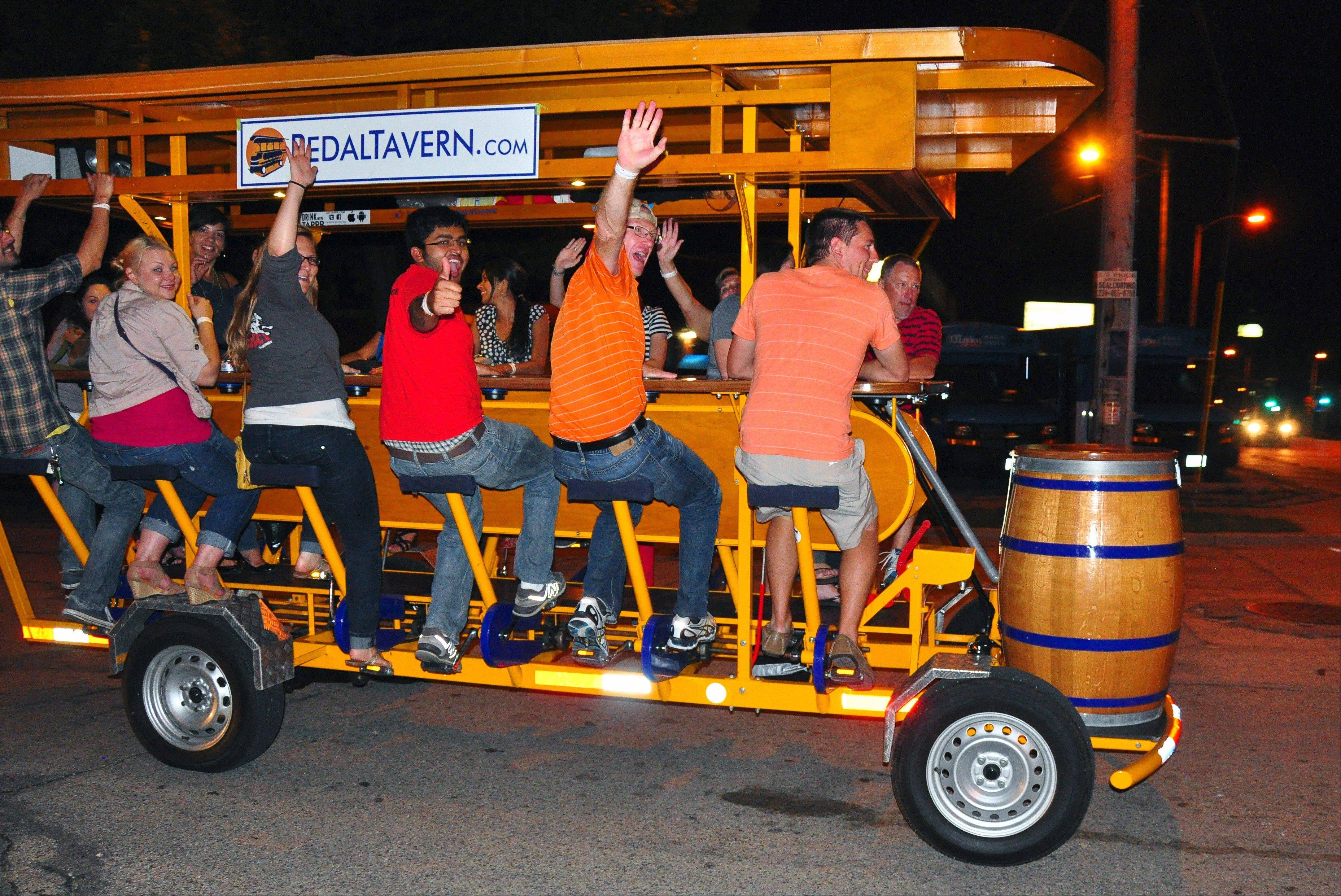 Revelers ride the Milwaukee Pedal Tavern from bar to bar in the Walker's Point neighborhood.