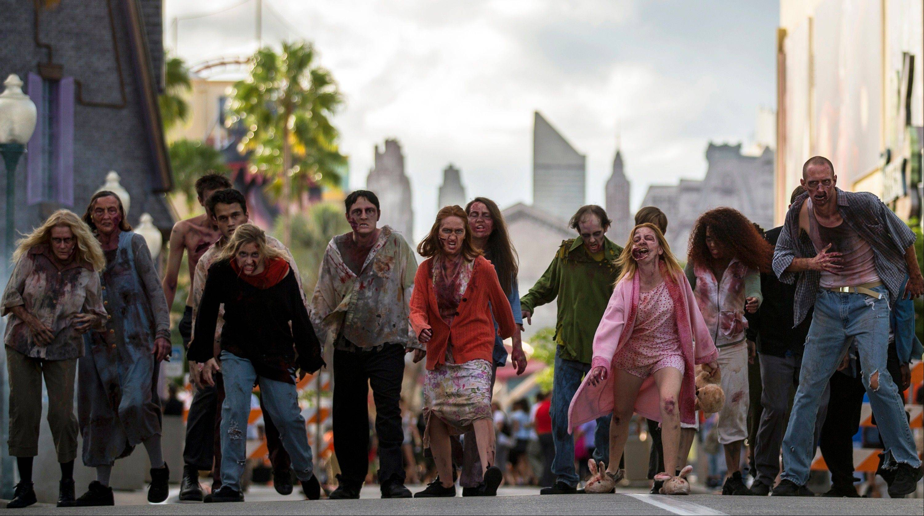 "Actors portray zombies inspired by AMC's ""The Walking Dead"" at Universal Orlando's Halloween Horror Nights, which take place on select nights through Nov. 2."