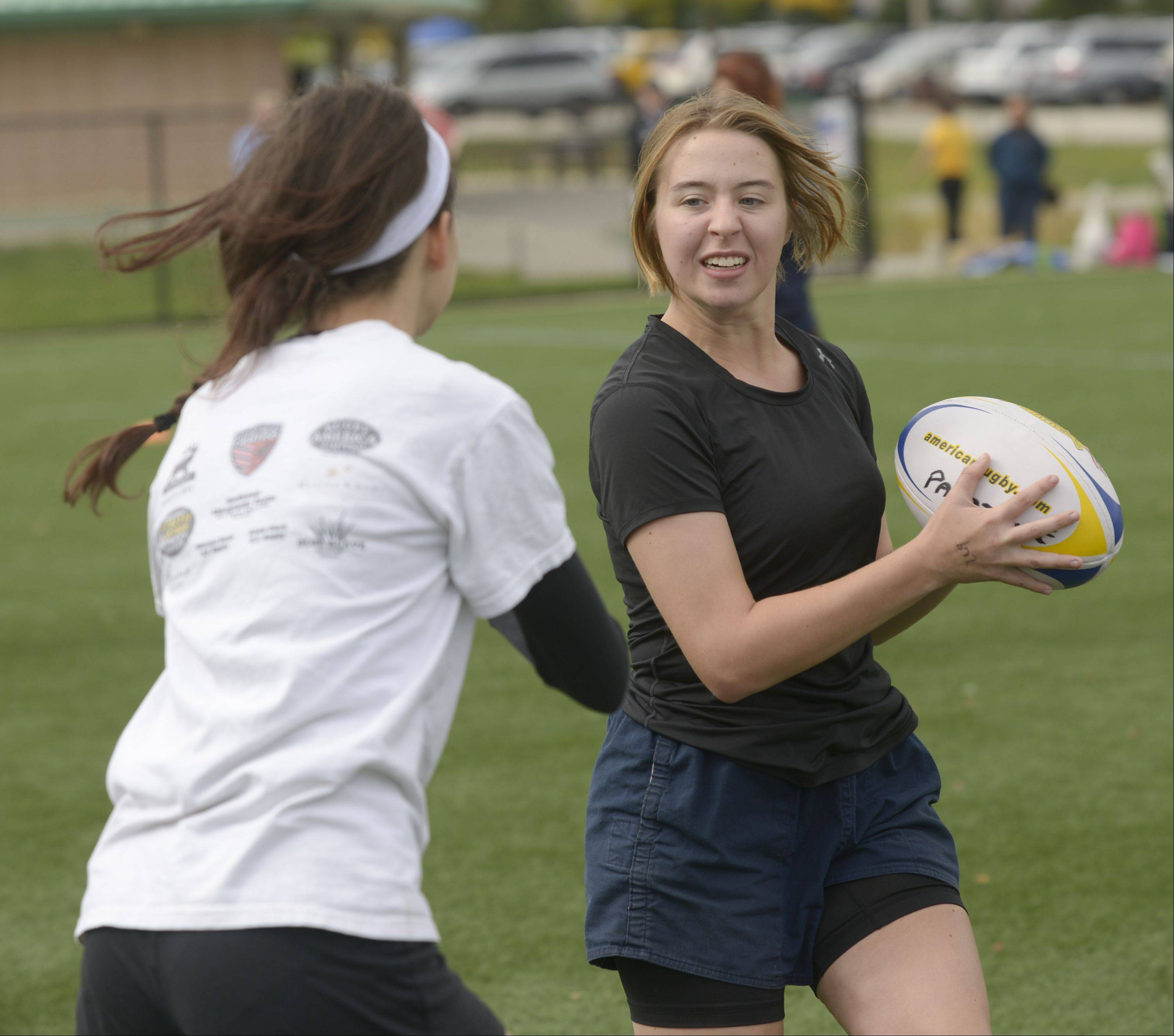 Maeve Gilbert, 14 of Chicago, left and Nicole Southerland, 15, of Palatine, run a drill Sunday during the Girls Day of Rugby hosted by the Illinois Youth Rugby Association at Olympic Park in Schaumburg.