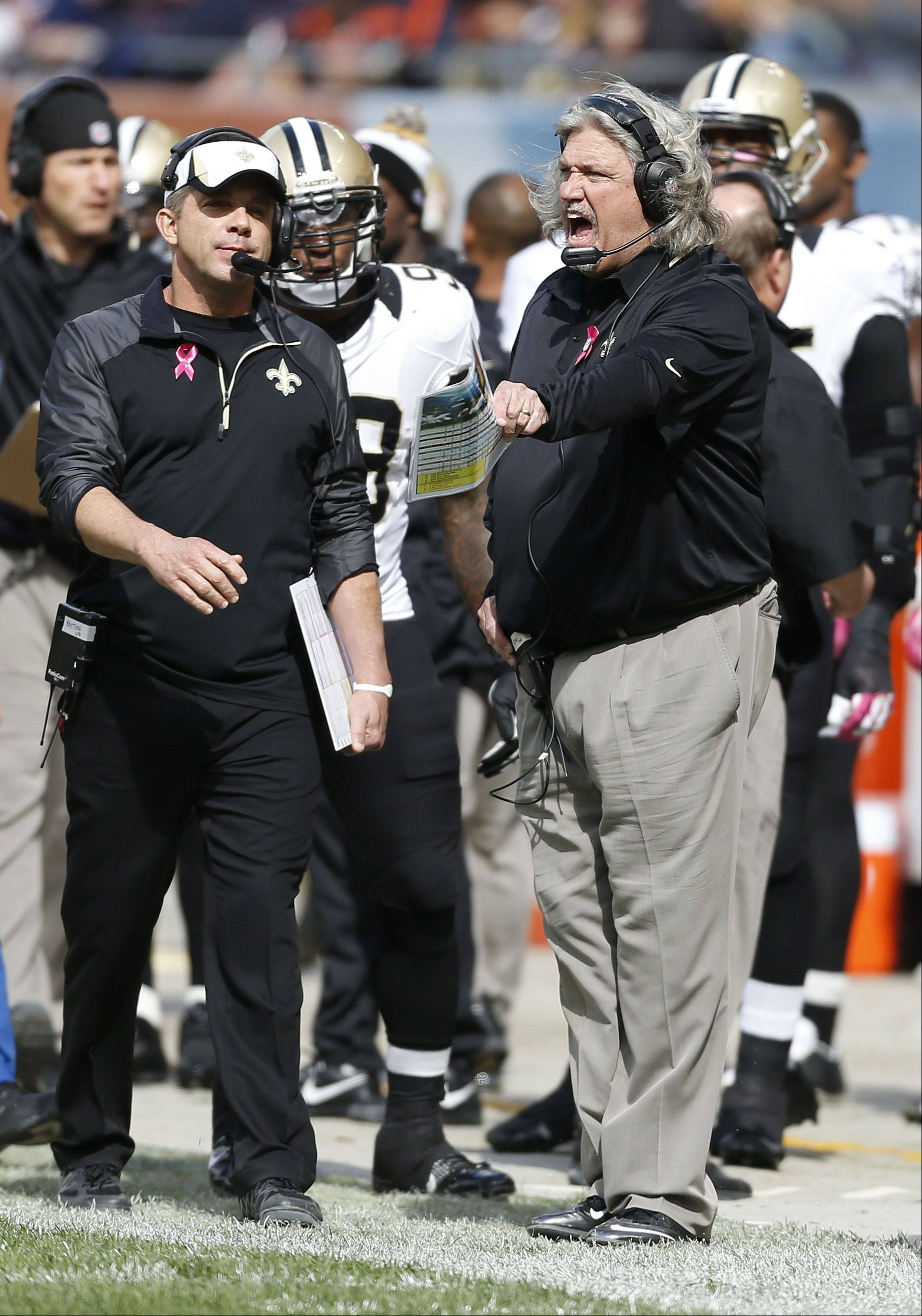 Saints head coach Sean Payton, left, and defensive coordinator Rob Ryan work the sidelines during Sunday's victory over the Bears at Soldier Field.