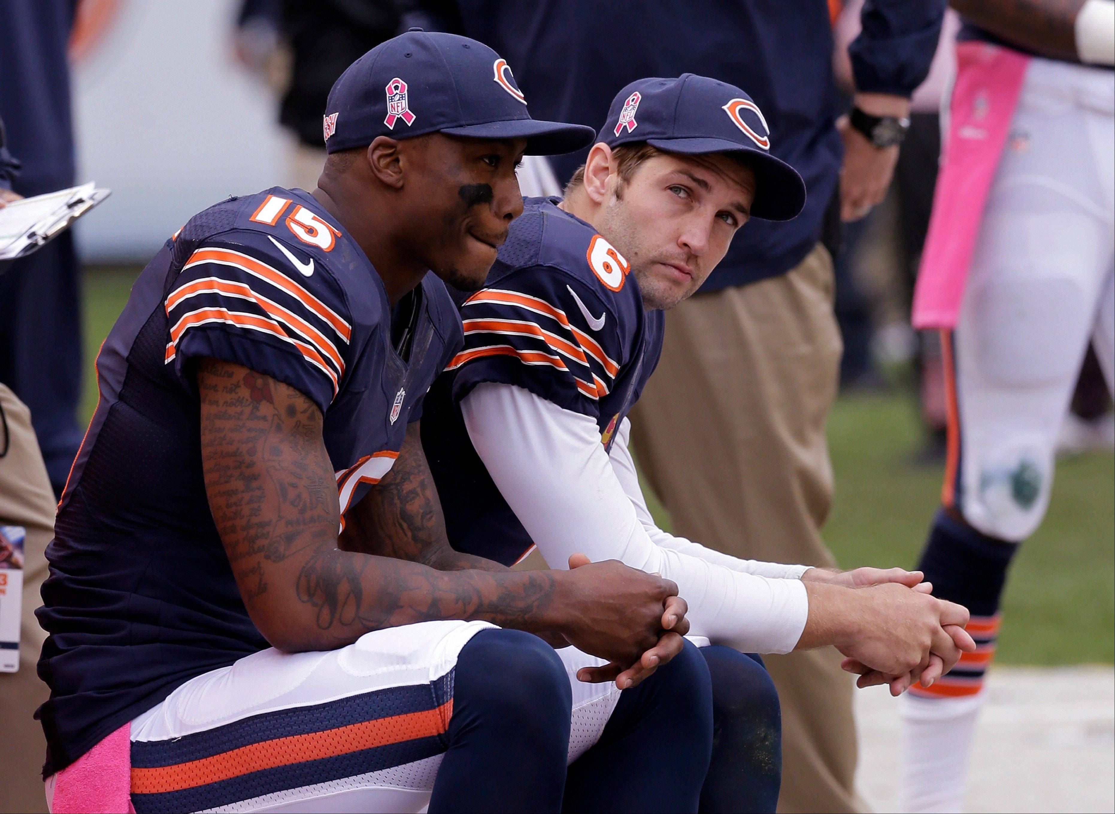Bears quarterback Jay Cutler, right, and wide receiver Brandon Marshall sit on the sideline during the second half of Sunday's loss to the New Orleans Saints.