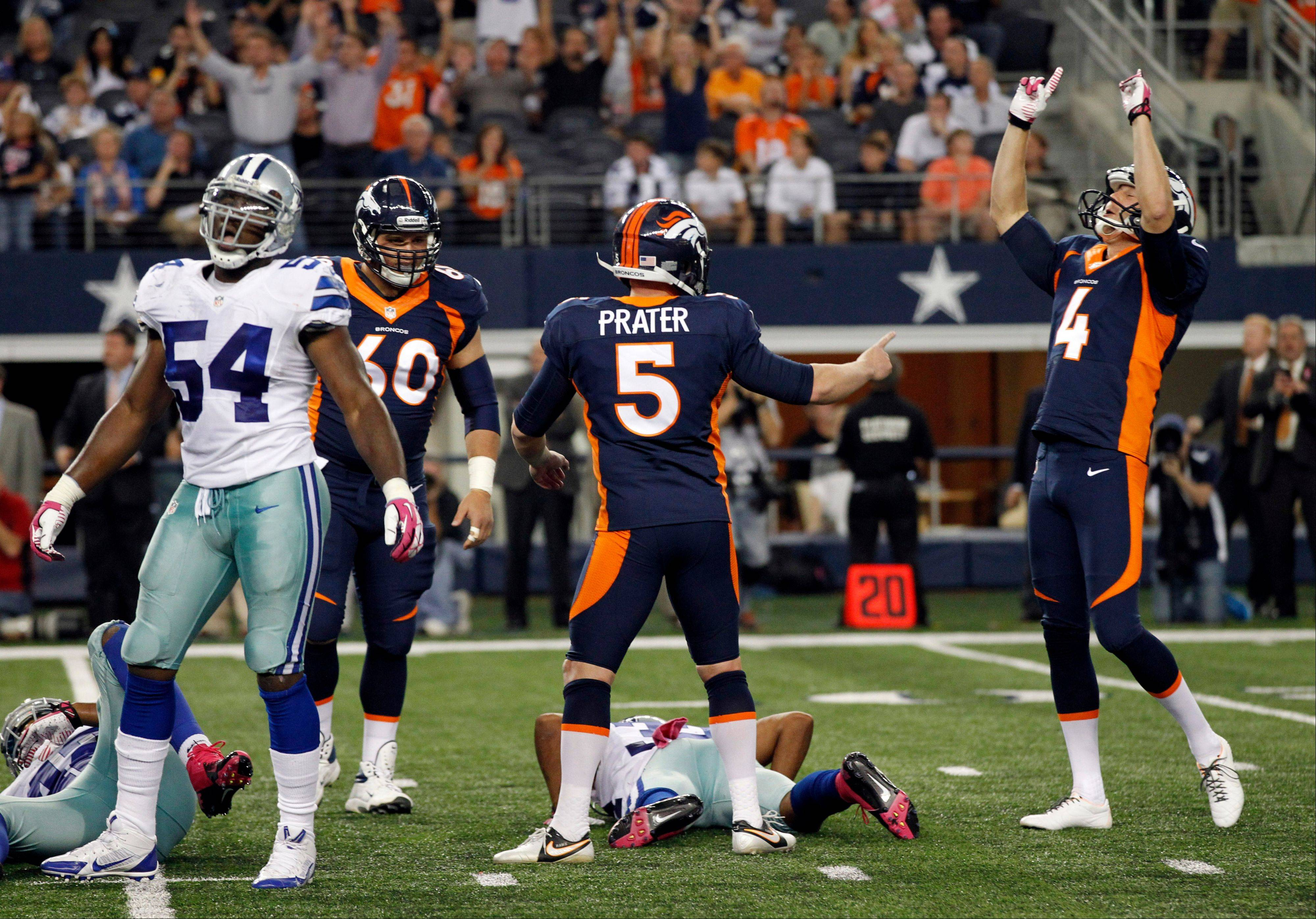 After Denver Broncos kicker Matt Prater (5) made the game-winning field goal against the Dallas Cowboys, he is joined in celebration by Britton Colquitt (4) and Steve Vallos (60) as Bruce Carter (54) reacts during the fourth quarter of an NFL football game Sunday, Oct. 6, 2013, in Arlington, Texas. The Broncos won 51-48.