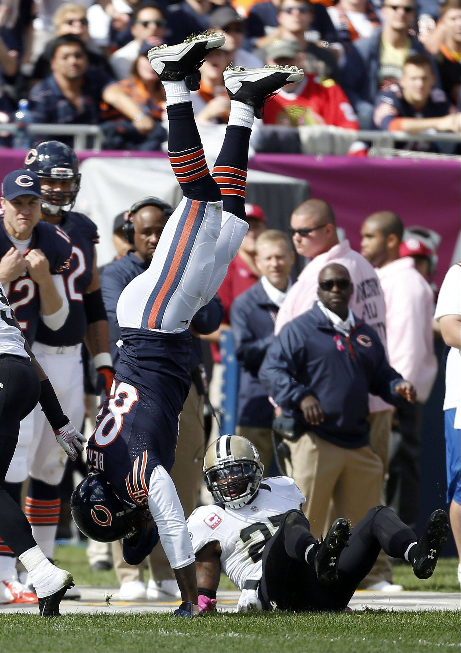 Chicago Bears tight end Martellus Bennett is flipped upside down by New Orleans Saints free safety Malcolm Jenkins.