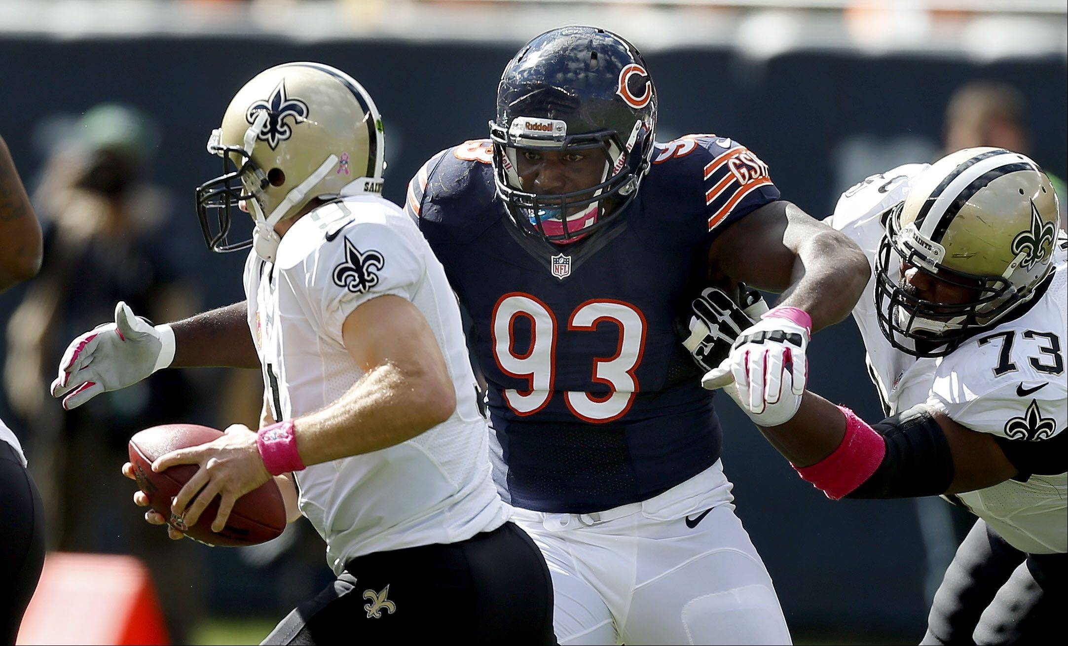 Chicago Bears defensive tackle Nate Collins sacks New Orleans Saints quarterback Drew Brees.