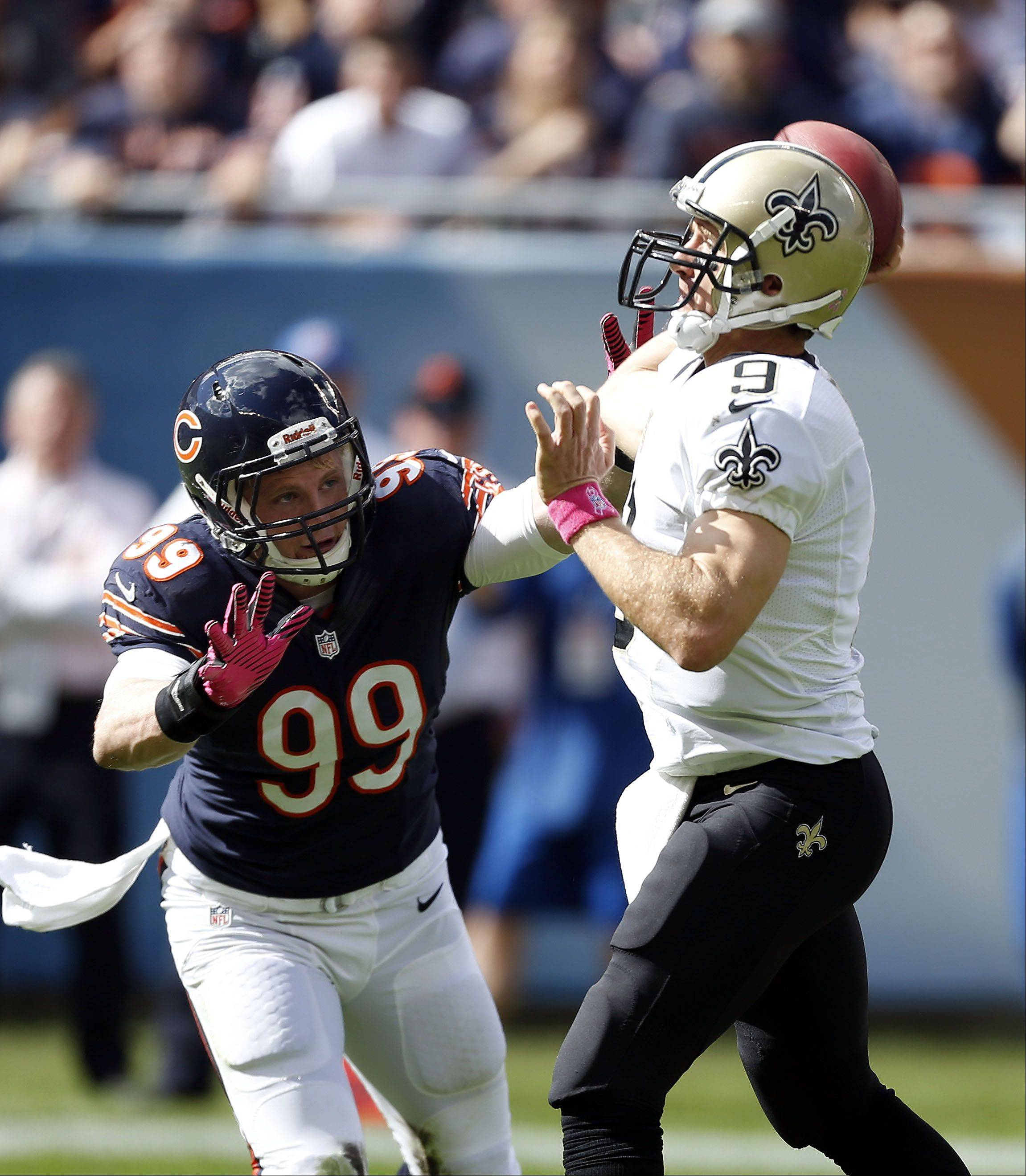 Chicago Bears defensive end Shea McClellin pressures New Orleans Saints quarterback Drew Brees.