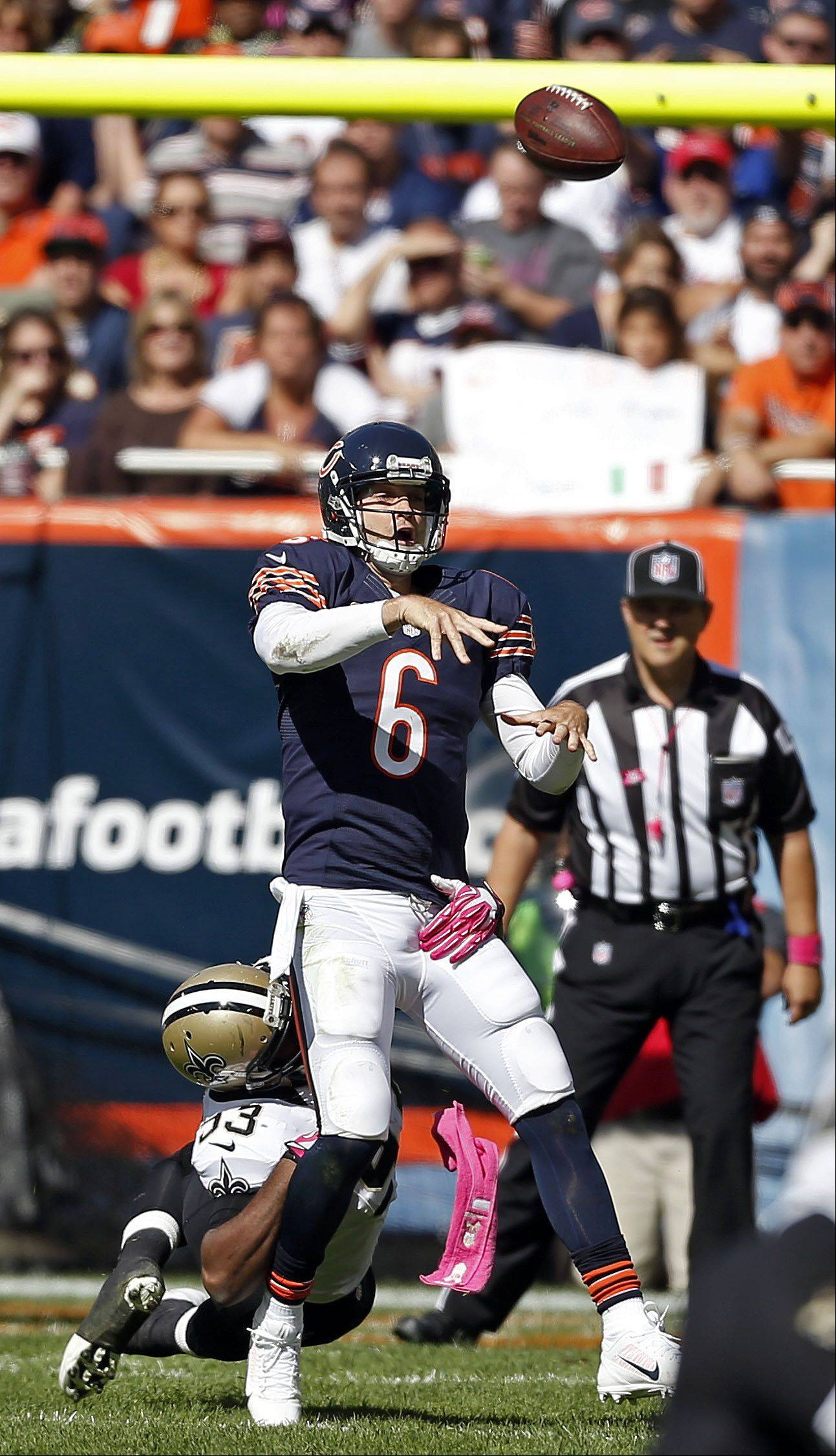 Chicago Bears quarterback Jay Cutler gets rid of the ball.