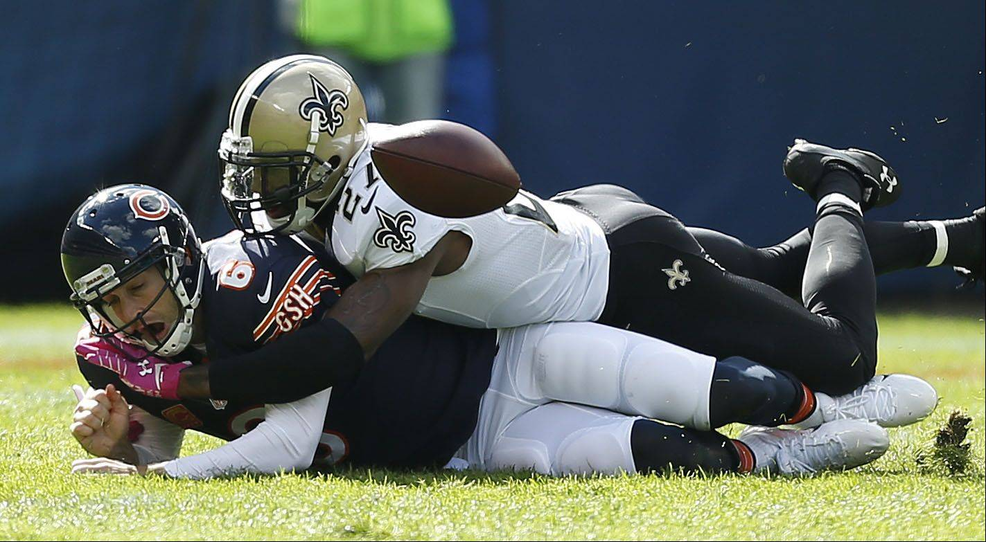 Chicago Bears quarterback Jay Cutler is sacked by New Orleans Saints free safety Malcolm Jenkins.