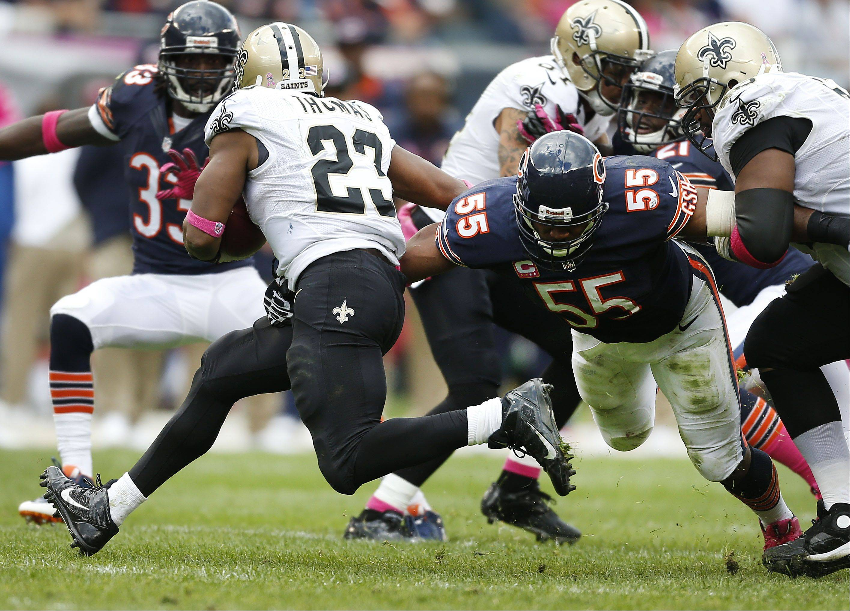 Chicago Bears outside linebacker Lance Briggs tries to wrap up New Orleans Saints running back Pierre Thomas during the Bears 26-18 loss to the New Orleans Saints.